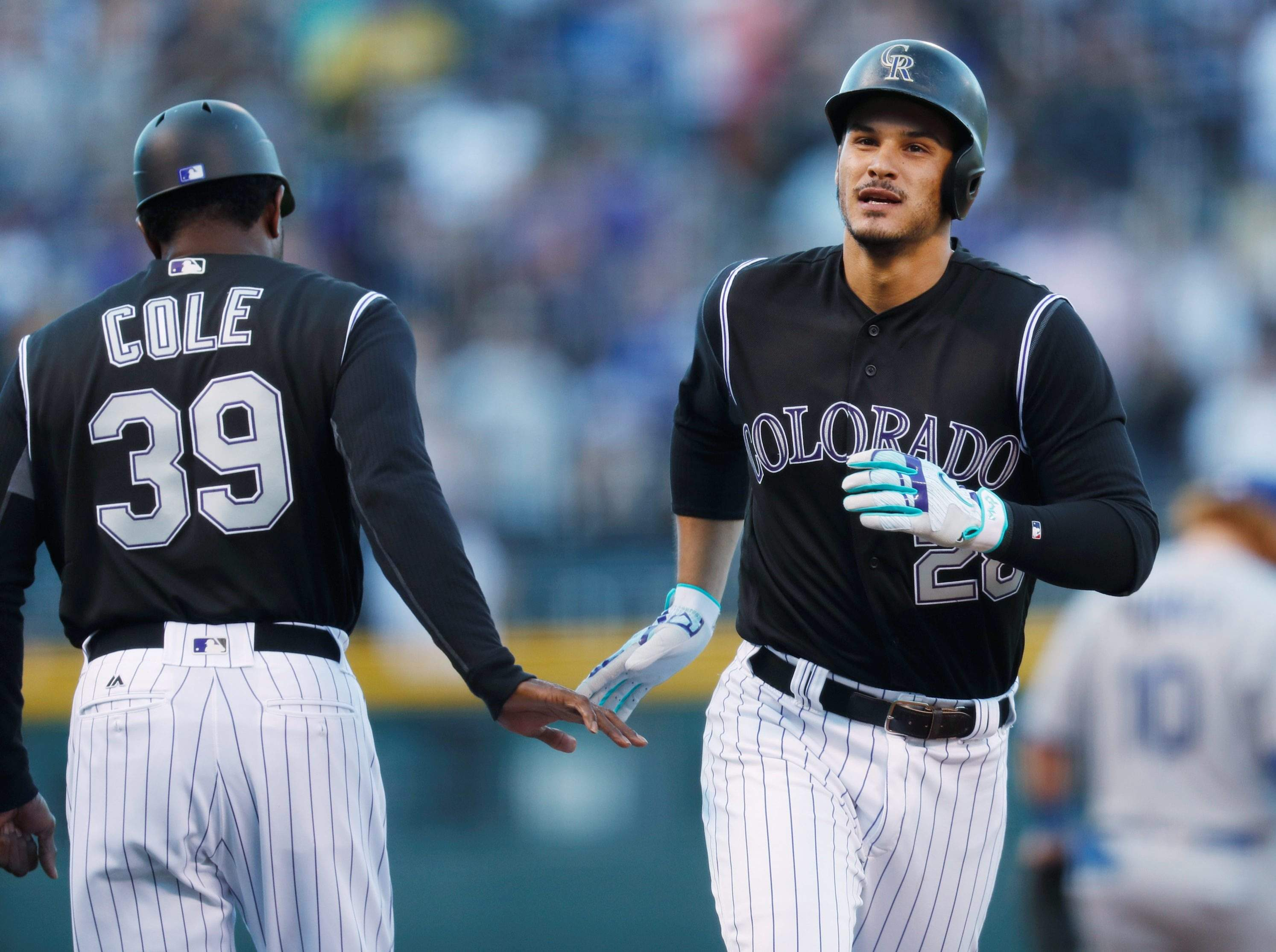 Left Congratulates Nolan Arenado Who Circles The Bases After Hitting A Solo Home Run Off Los Angeles Dodgers Starting Pitcher Clayton Kershaw In