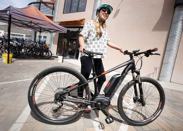 Ali Tracey, with Second Avenue Sports, in April describes some of the features on an e-bike that they sell at the store.