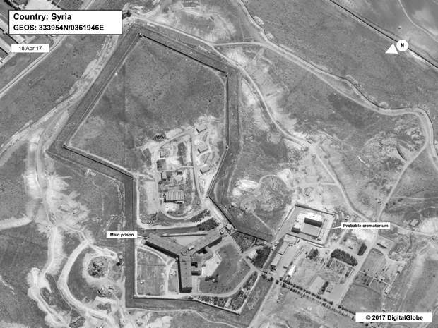 This image provided by the State Department and DigitalGlobe, taken April 18, 2017, a satellite image of what the State Department described as a building in a prison complex in Syria that was modified to support a crematorium. The Trump administration accused the Syrian government of carrying out mass killings of thousands of prisoners and burning the dead bodies in a large crematorium outside the capital. It also stepped up criticism of Iran and Russia for supporting the Syrian government.
