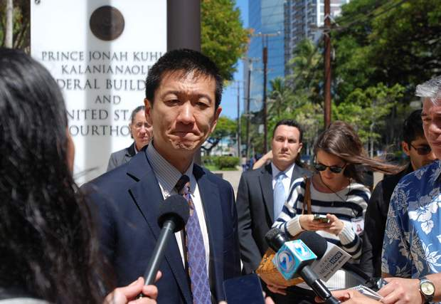 Hawaii Attorney General Douglas Chin speaks outside federal court in Honolulu, Hawaii, on March 29. Three federal appellate court judges in Seattle on Monday, May 15, will hear the appeal of Hawaii's challenge to President Trump's travel ban targeting six predominantly Muslim countries.