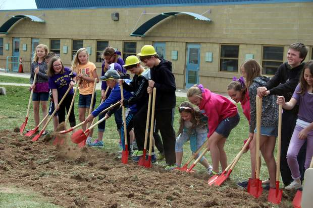 Members of the Bayfield Elementary Student Council start tossing dirt in a groundbreaking for a new elementary school and renovation of the current campus.
