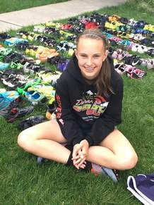 Kenzie Galloway of Miller Middle School poses with soccer cleats she collected and donated. The cleats will be sent to Mwanza, Tanzania as part of the Health and Hope Foundation.