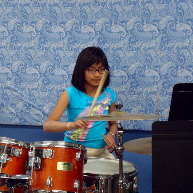 "Drummer Ruth Bernardo holds down the rhythm for the band ""The MetroGnomes."""