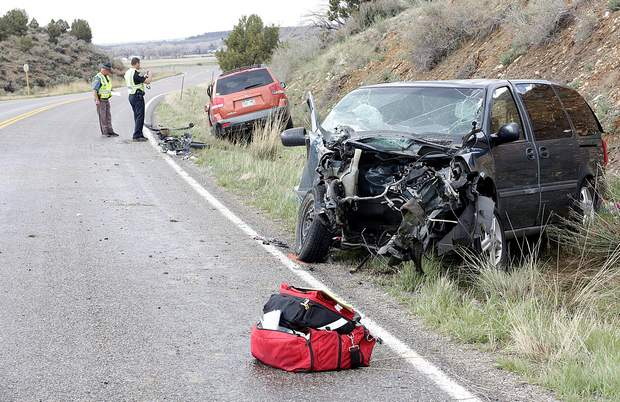 Colorado State Patrol investigates the scene of a head-on crash April 18, 2016, on La Plata Highway (Colorado Highway 140). Neysha Candelaria, the driver of a minivan, pleaded guilty Thursday to careless driving causing injury and careless driving resulting in death.