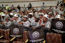 Laborers union members cheer during a meeting of the Las Vegas Stadium Authority board, Thursday, May 18, 2017, in Las Vegas. The public entity that oversees the proposed stadium where the Raiders want to start playing in 2020 has approved a conditional lease agreement for the facility. (AP Photo/John Locher)