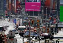 A smashed car, lower right, sits on the corner of Broadway and 45th Street in New York's Times Square after plowing through a crowd of pedestrians at lunchtime on Thursday.