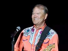 Singer Glen Campbell performs during his Goodbye Tour in Little Rock, Ark., on Sept. 6, 2012. Campbell died Tuesday. He was 81.