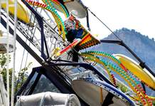 Kyle Good climbs down the Alpine Swinger ride on Tuesday as the Great Northern A'Fair Carnival prepares to open at the La Plata County Fair.