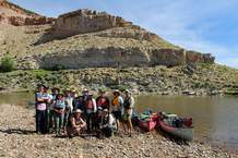 Dedicated river rats all, we pose for a group photo where the lush grasses of the upper Yampa give way to more rugged canyons and sagebrush. Pam Fitz led the tour for Centennial Canoe Outfitters, the largest canoe outfitter in Colorado.