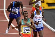 Ethiopia's Muktar Edris, left, celebrates after winning the Men's 5000 meters final at the World Athletics Championships in London Saturday, Aug. 12, 2017. (AP Photo/Martin Meissner)