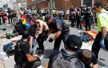 Rescue personnel help injured people after a car ran into a large group of protesters after a white nationalist rally in Charlottesville, Va., on Saturday.