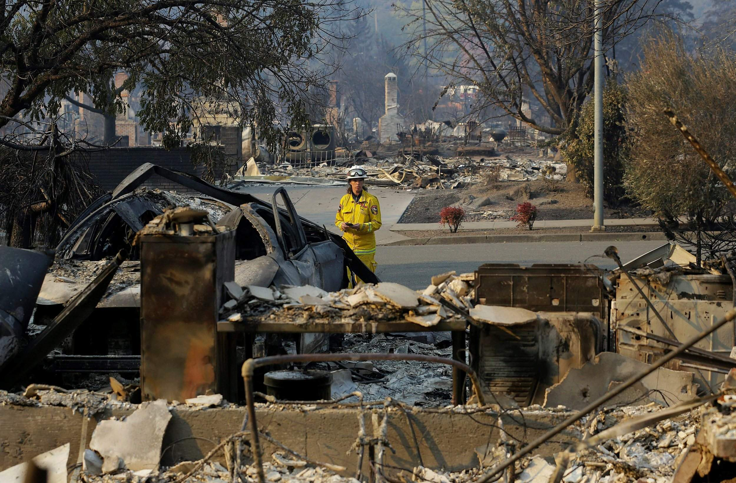 cal fire forester kim sone inspects damage at homes destroyed by fires in santa rosa calif on thursday gusting winds and dry air forecast for thursday
