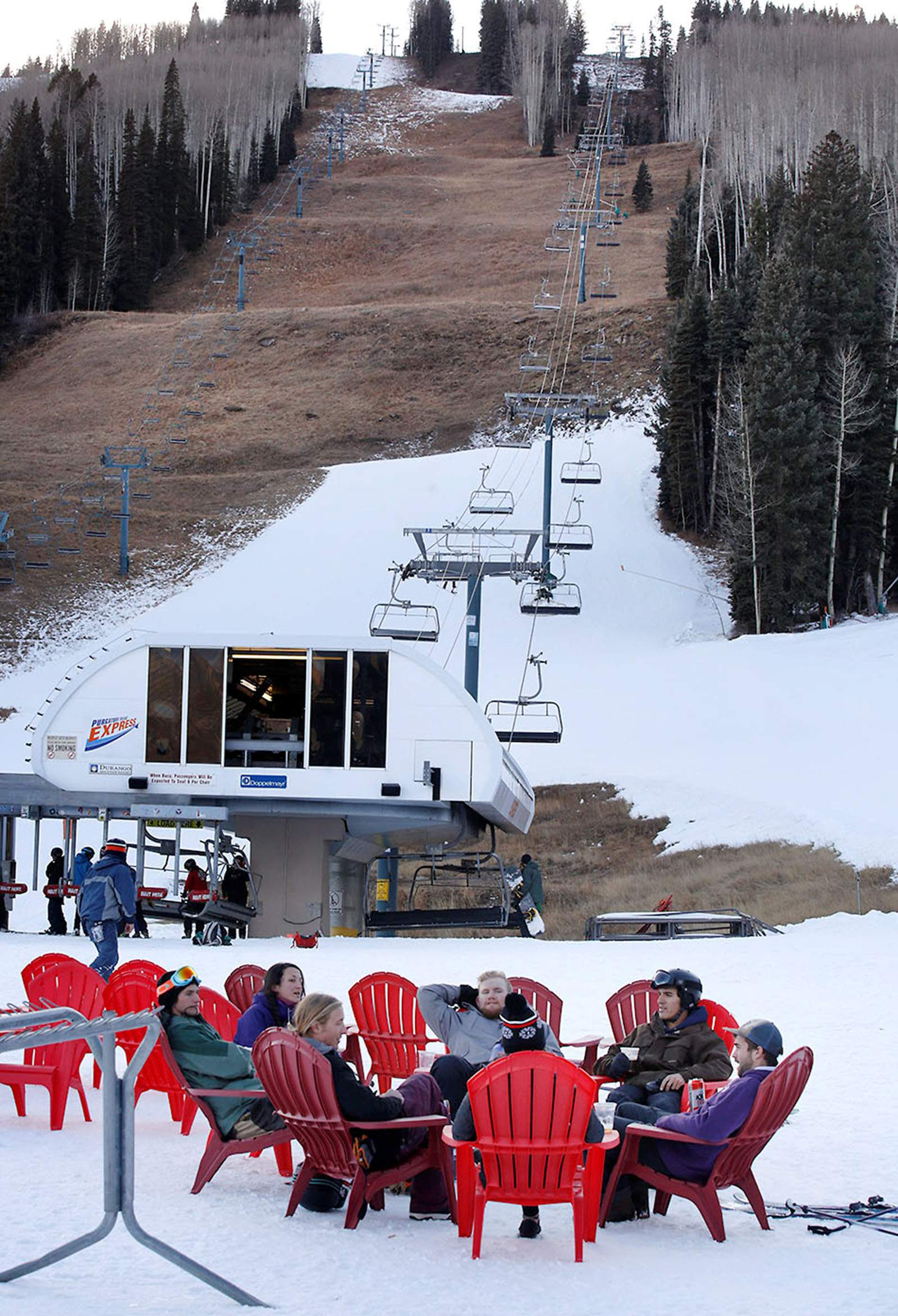Dry weather leaves many in durango wondering will it ever snow a group of friends lounges at the base of purgatory resort on wednesday in man made snow purgatory general manager colin mcbeath said all of the snow at madrichimfo Images