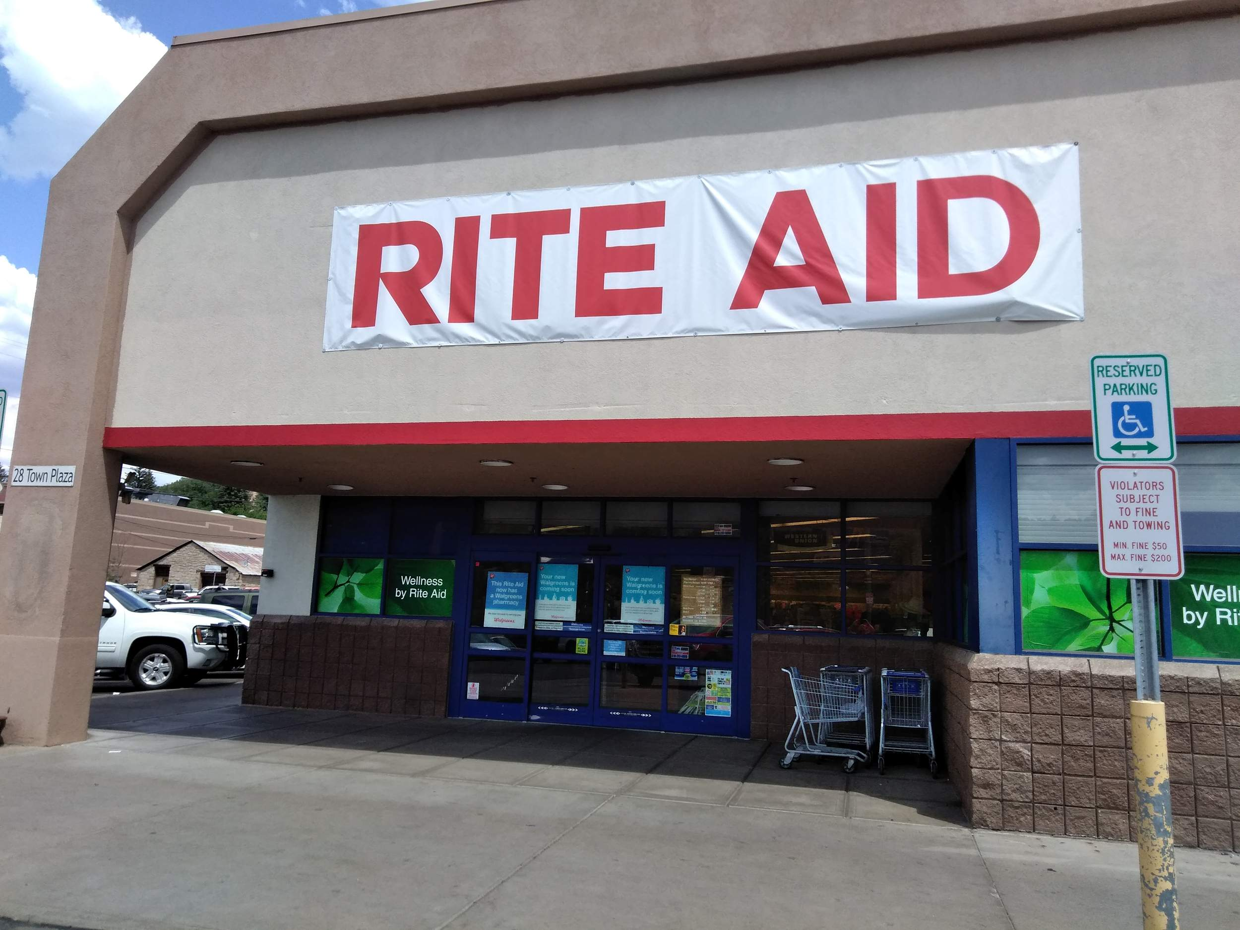 the rite aid in town plaza is transitioning to become a walgreens the store is expected to be under the walgreens banner by the end of the month
