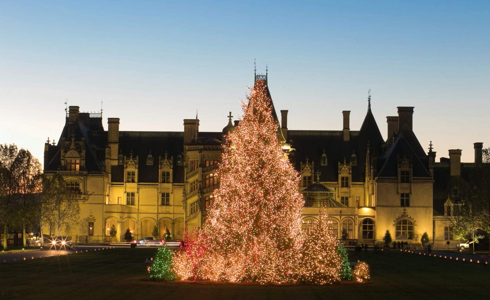 A Christmas Tree Is Covered In Lights Outside The Biltmore House In  Asheville, N.C. Lonely Planet Has Named Asheville The No. 1 Destination On  Its U201cBest Of ...
