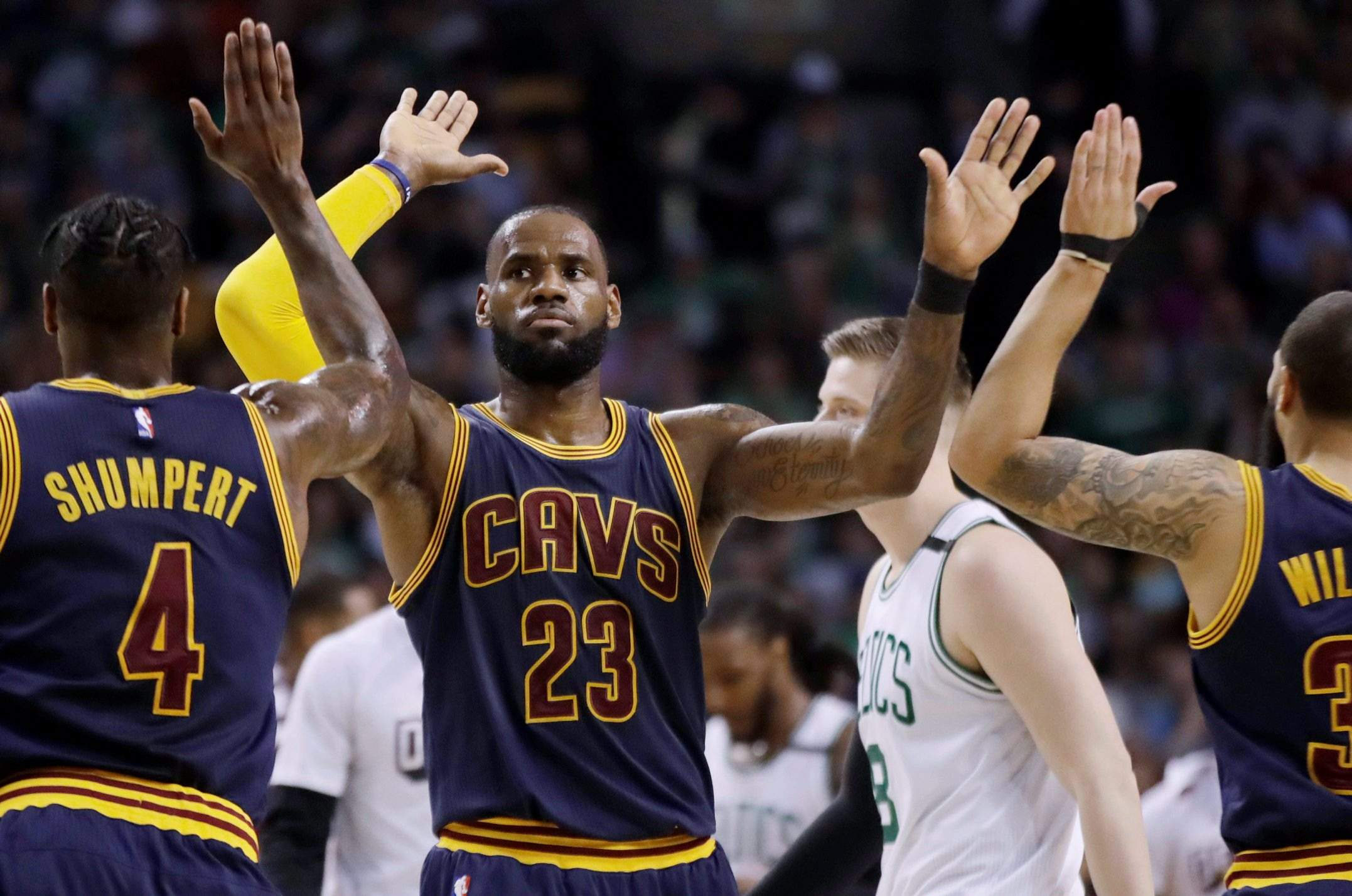 01c26219faa Cleveland Cavaliers forward LeBron James trades high-fives with teammates  Iman Shumpert