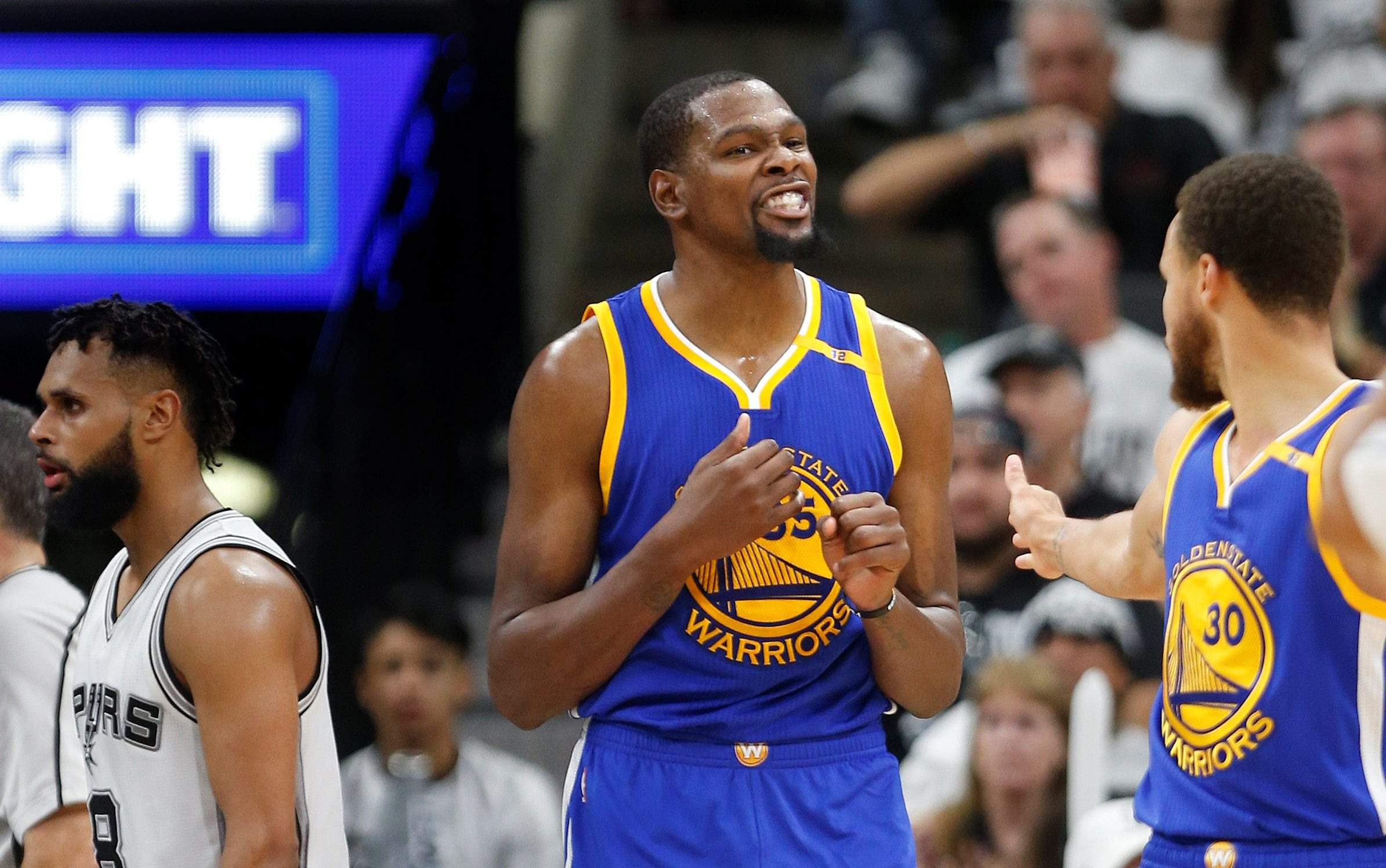 fcd9fba5f021 Golden State Warriors forward Kevin Durant (35) reacts with Golden State  Warriors guard Stephen Curry (30) after a basket during the first half in  Game 3 of ...