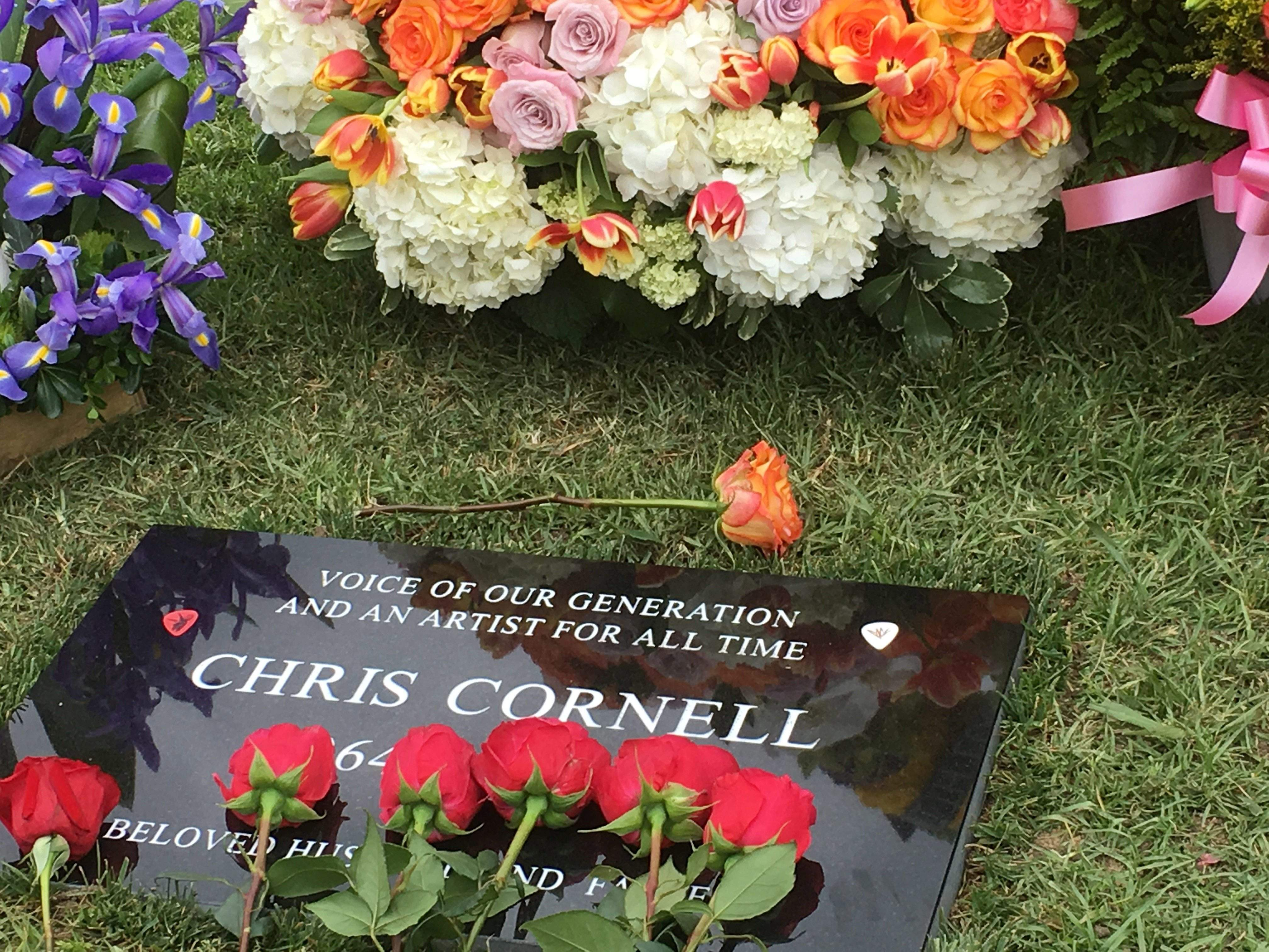 Chris cornell remembered as voice of our generation flowers adorn the grave marker for musician chris cornell at the hollywood forever cemetery on friday in los angeles cornell 52 who gained fame as the izmirmasajfo