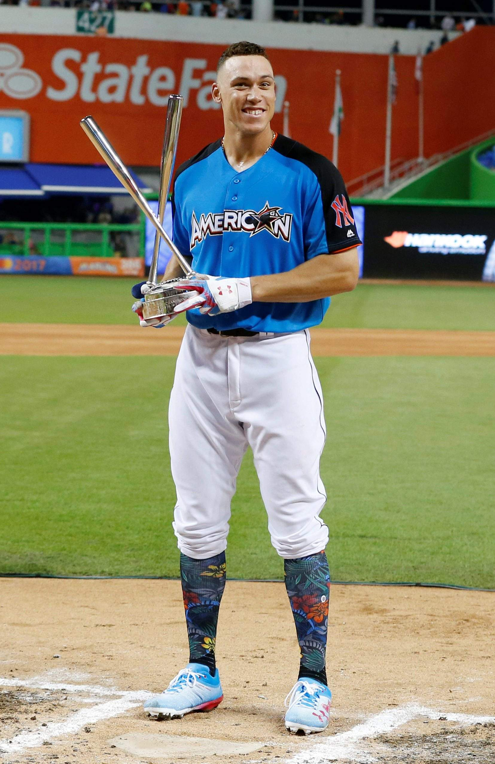 e266df2663e New York Yankees  Aaron Judge shows the trophy after winning the MLB  All-Star Home Run Derby Monday in Miami.