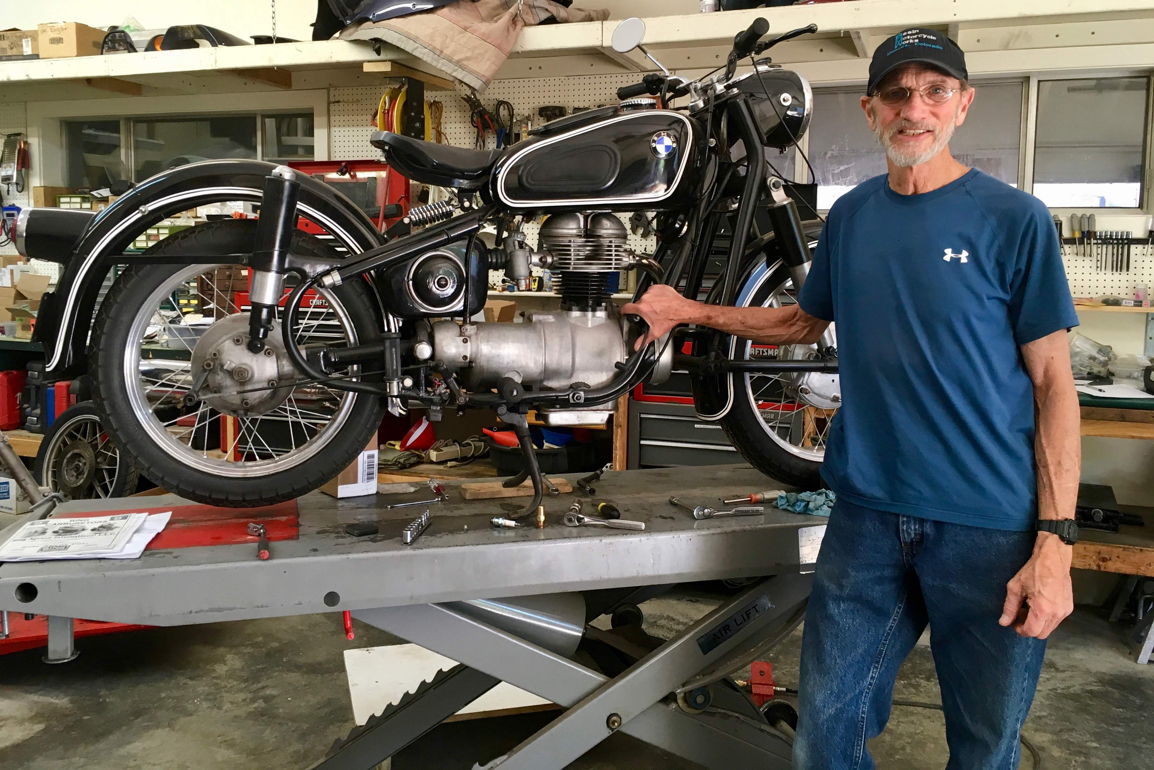 harry hill with a 1959 r26 single cylinder bmw motorcycle that hes repairing in his shop basin motorcycle works at 41 s main st in mancos