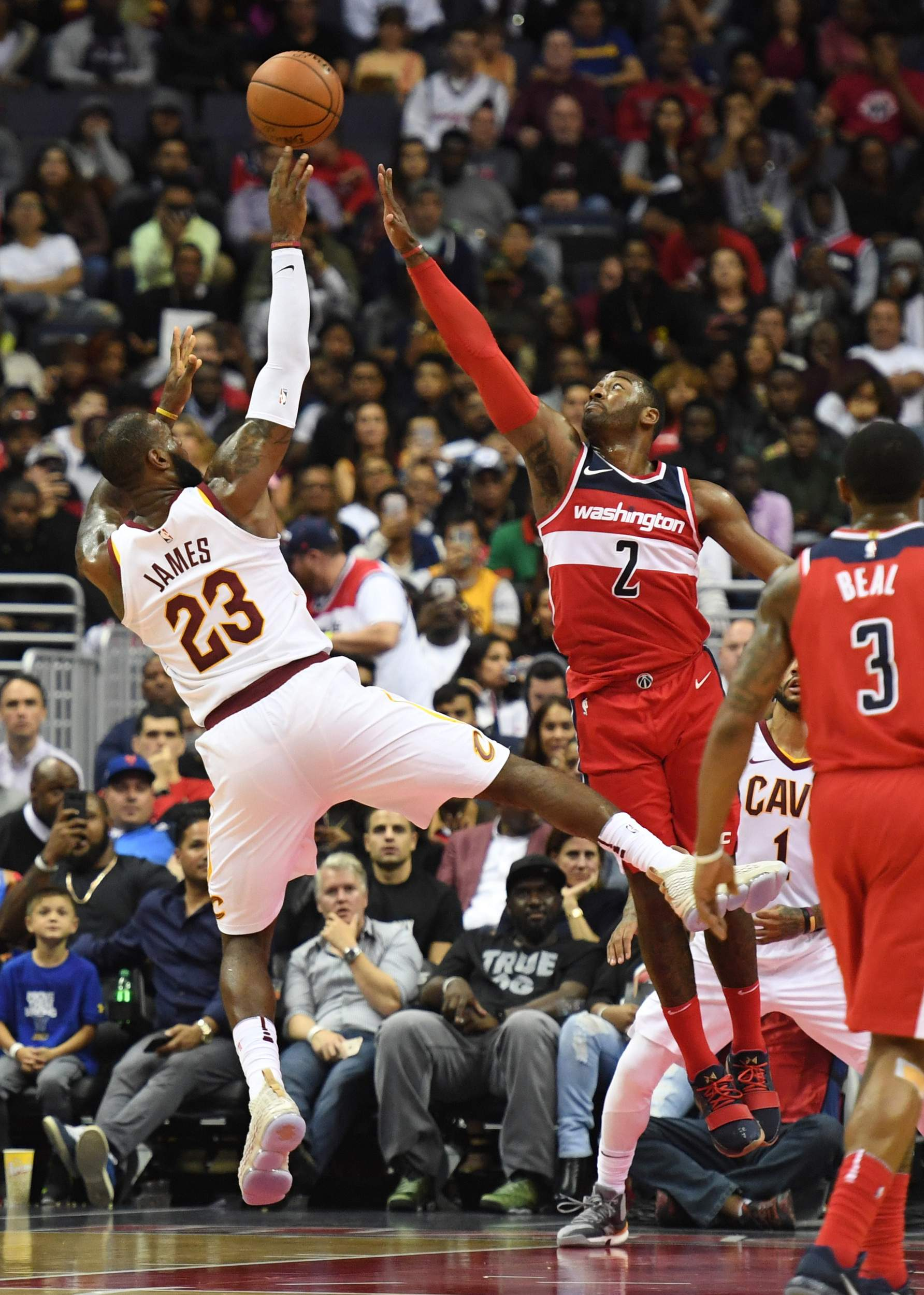 4df17a17635b LeBron James of the Cavaliers shoots over John Wall of the Washington  Wizards during their game at Capital One Arena in Washington