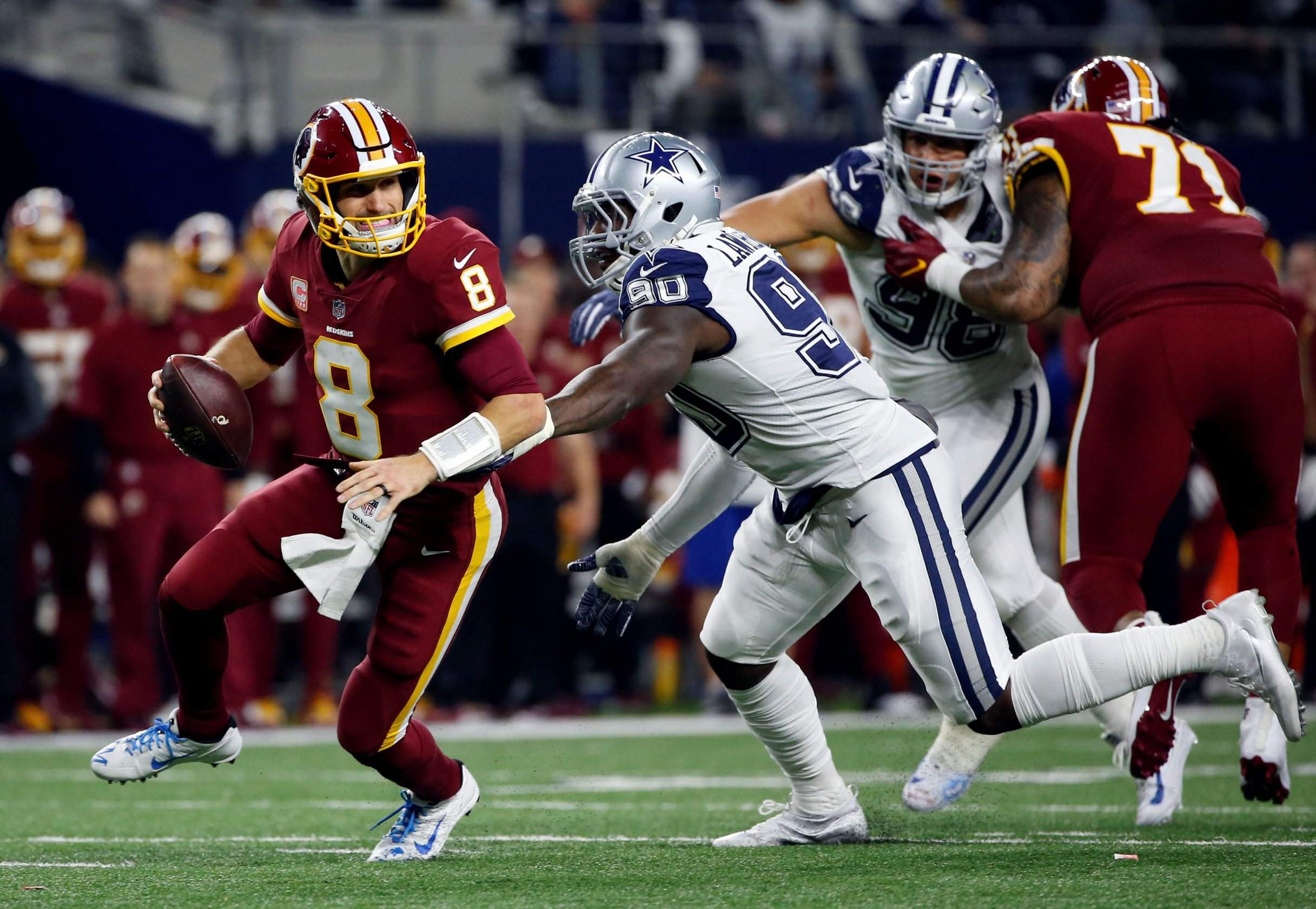 956ea3d53b1 Washington Redskins quarterback Kirk Cousins (8) scrambles out of the  pocket escaping pressure from Dallas Cowboys defensive end DeMarcus  Lawrence Thursday ...