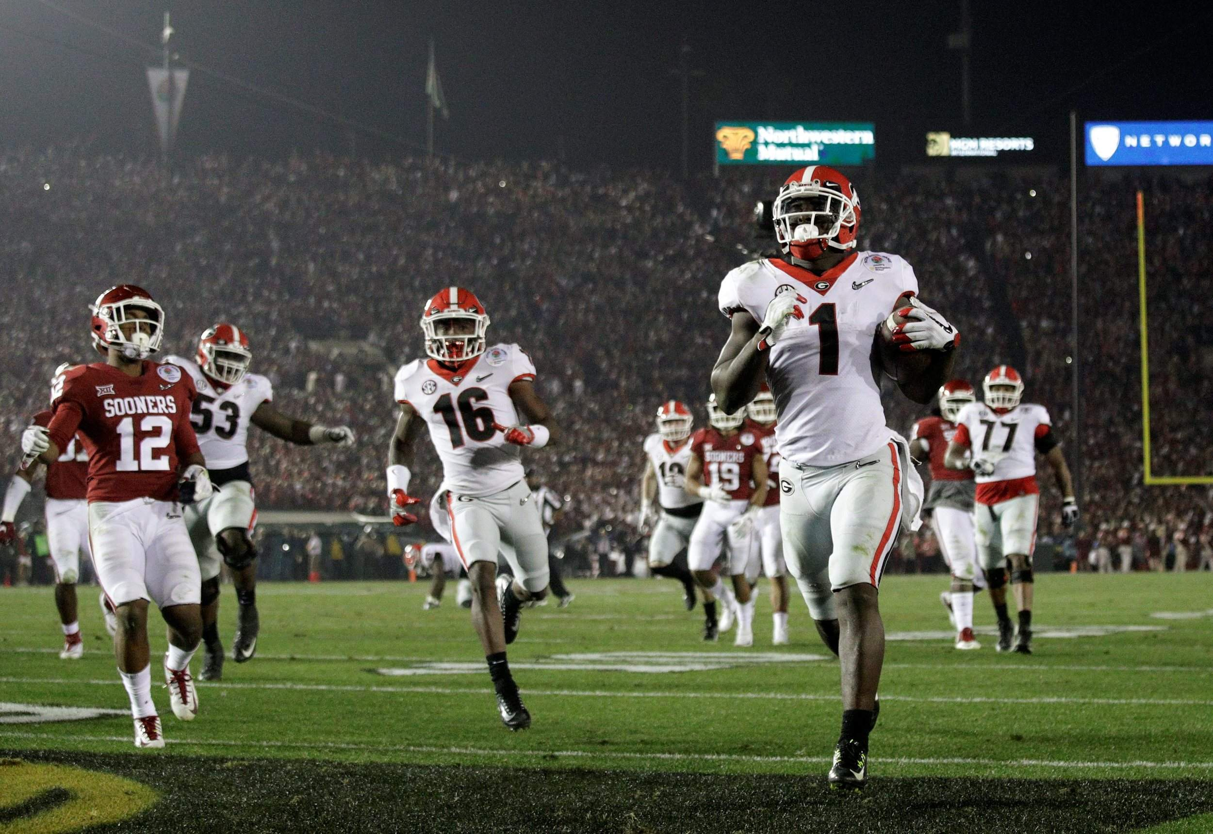 ba3643ed3 Georgia running back Sony Michel (1) scores a touchdown in overtime against  Oklahoma in the Rose Bowl on Monday in Pasadena