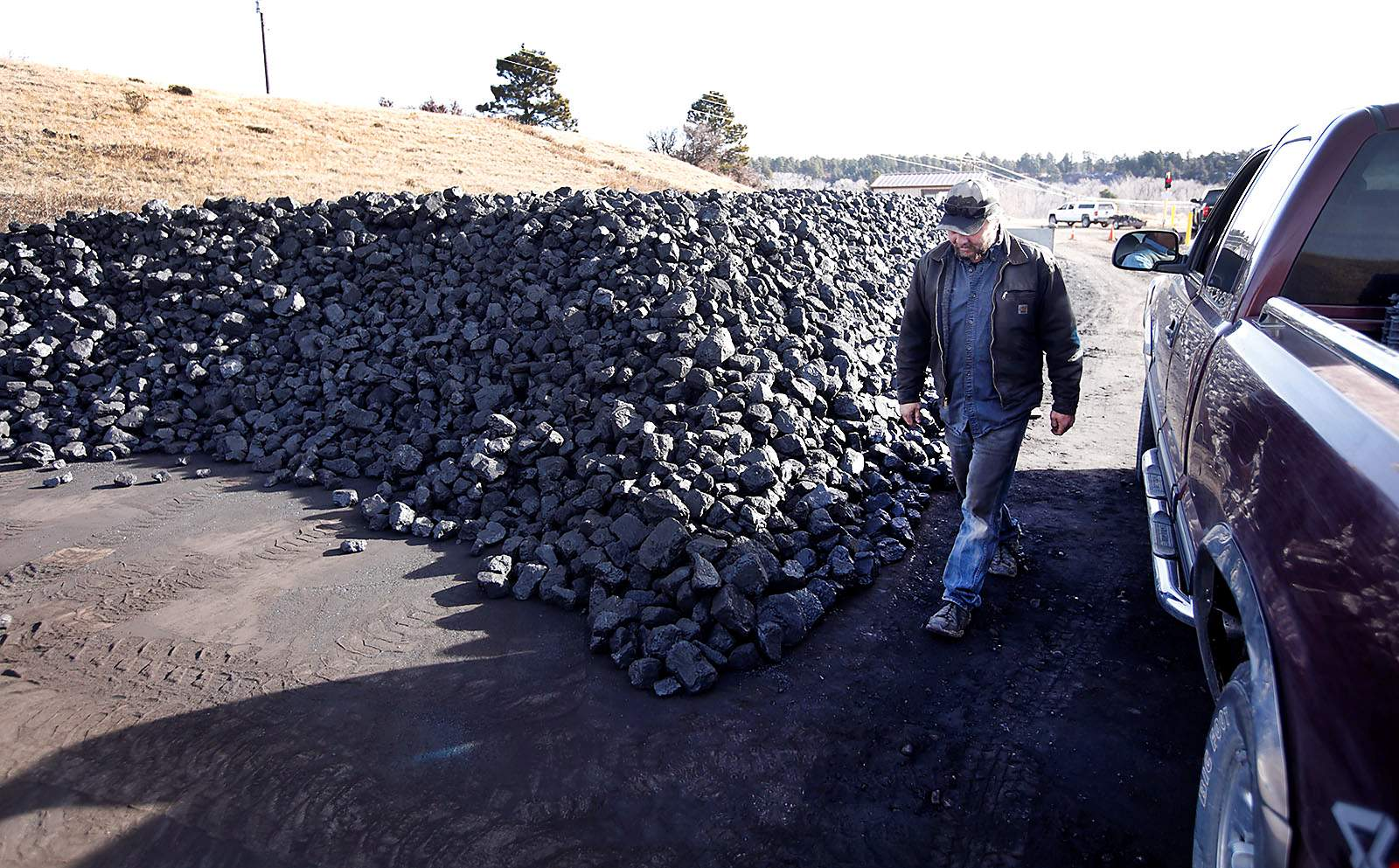 For warmth, some households still burn coal