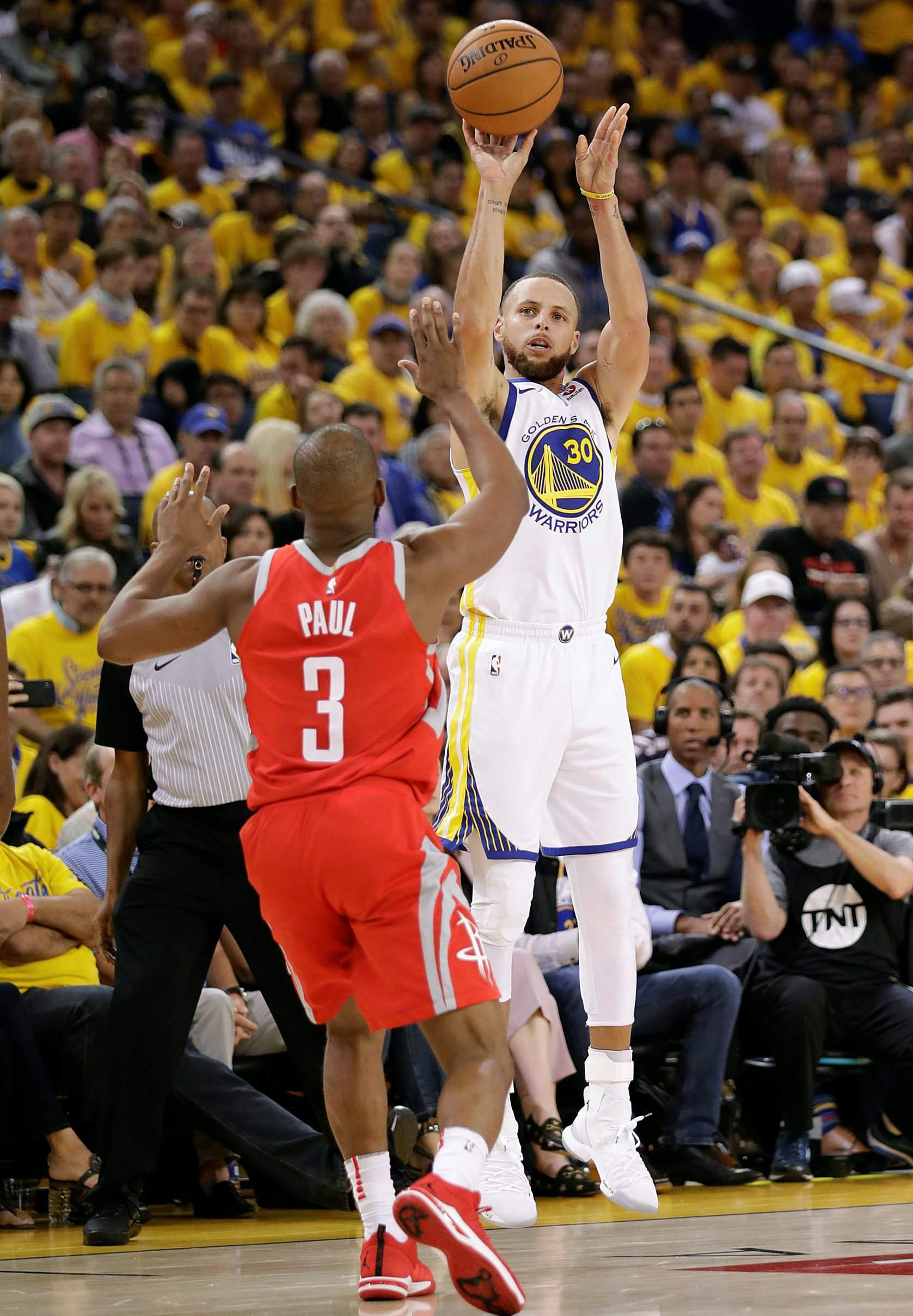 Golden State Warriors guard Stephen Curry (30) shoots against Houston  Rockets guard Chris Paul (3) during the second half of Game 3 of the  Western ... 2871fd09b
