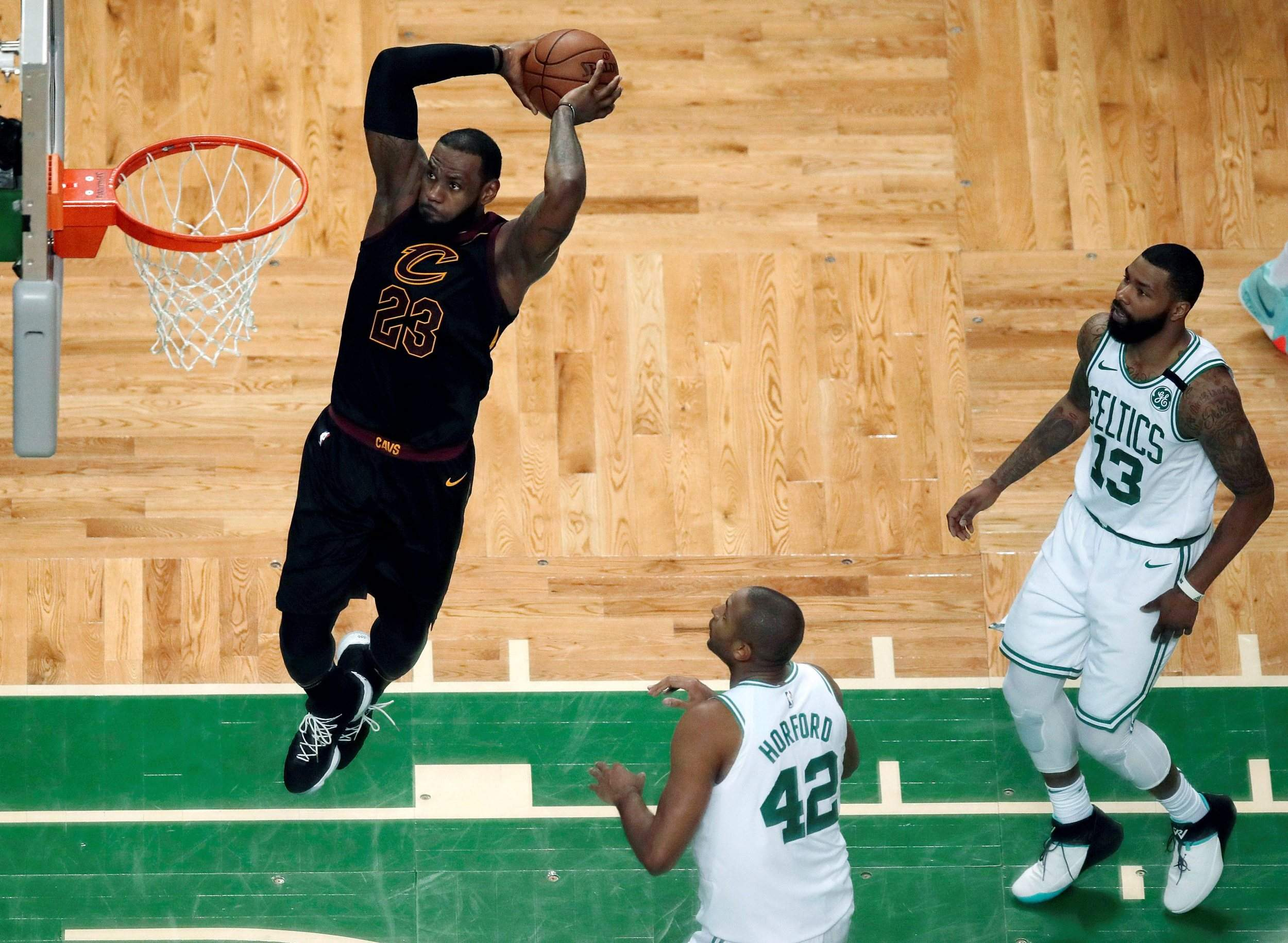 472752c4809 Cleveland Cavaliers forward LeBron James soars to dunk in front of Boston  Celtics forward Al Horford (42) and forward Marcus Morris (13) during the  first ...