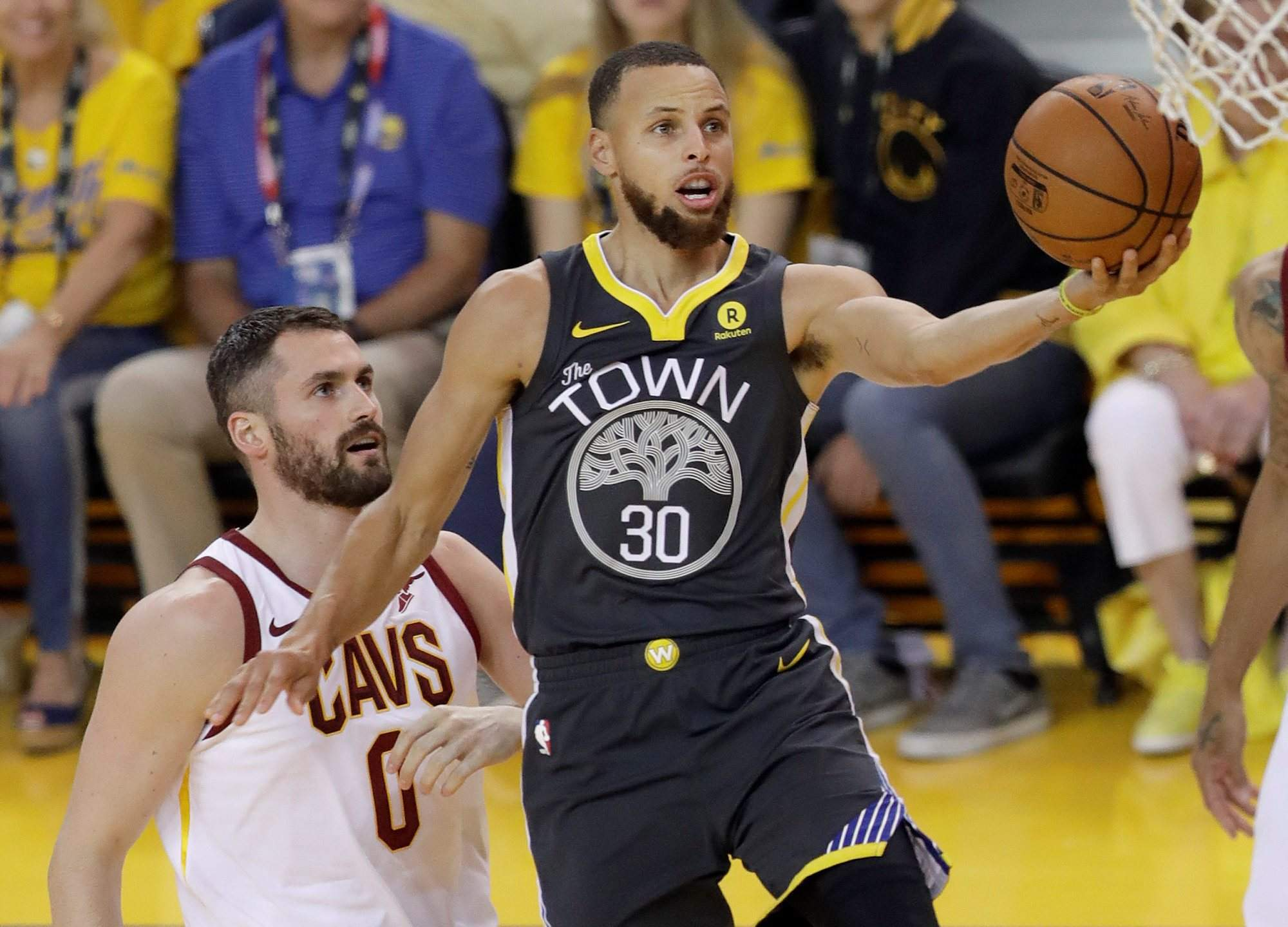 Golden State Warriors guard Stephen Curry (30) shoots against Cleveland  Cavaliers forward Kevin Love (0) during the first half of Game 2 of the NBA  Finals ... 46227c8ef5e4