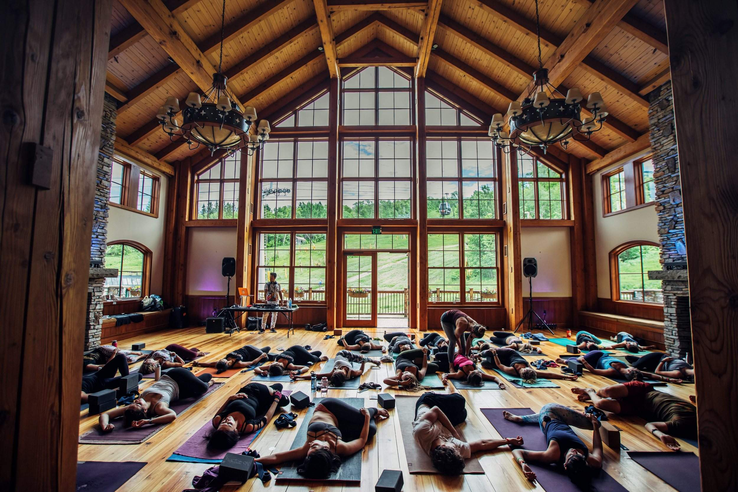 Participants Work Out During Wanderlust Stratton 2017 In Bondville, Vermont