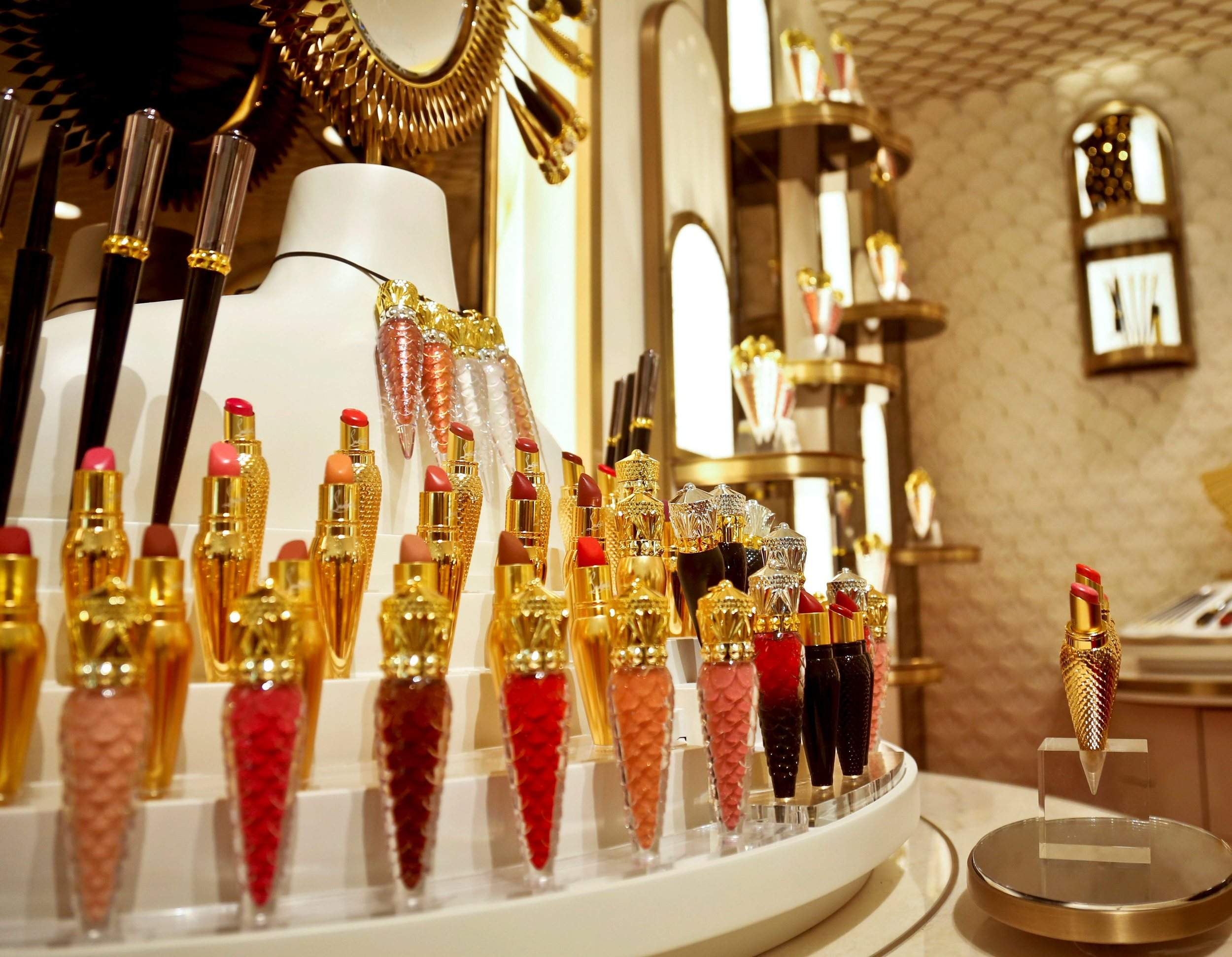 07bf09b1487 Cosmetic products are displayed inside the new Christian Louboutin space at  the revamped second floor devoted to beauty at Saks Fifth Avenue in New  York on ...
