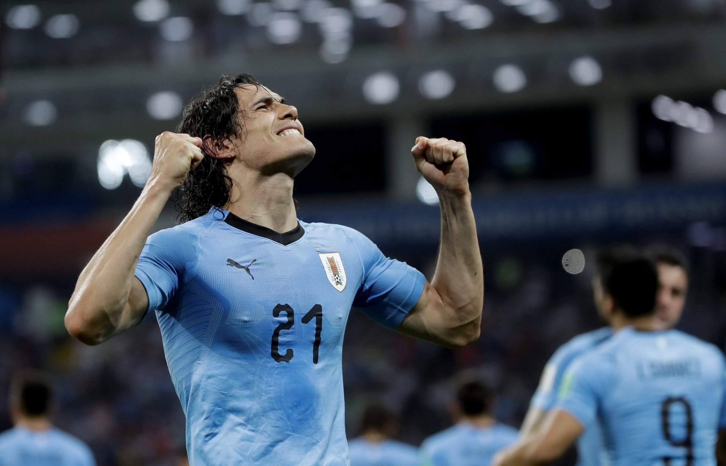 0b4cb3690 Uruguay s Edinson Cavani celebrates after scoring his side s second goal  during the Round of 16 match between Uruguay and Portugal at the 2018  soccer World ...