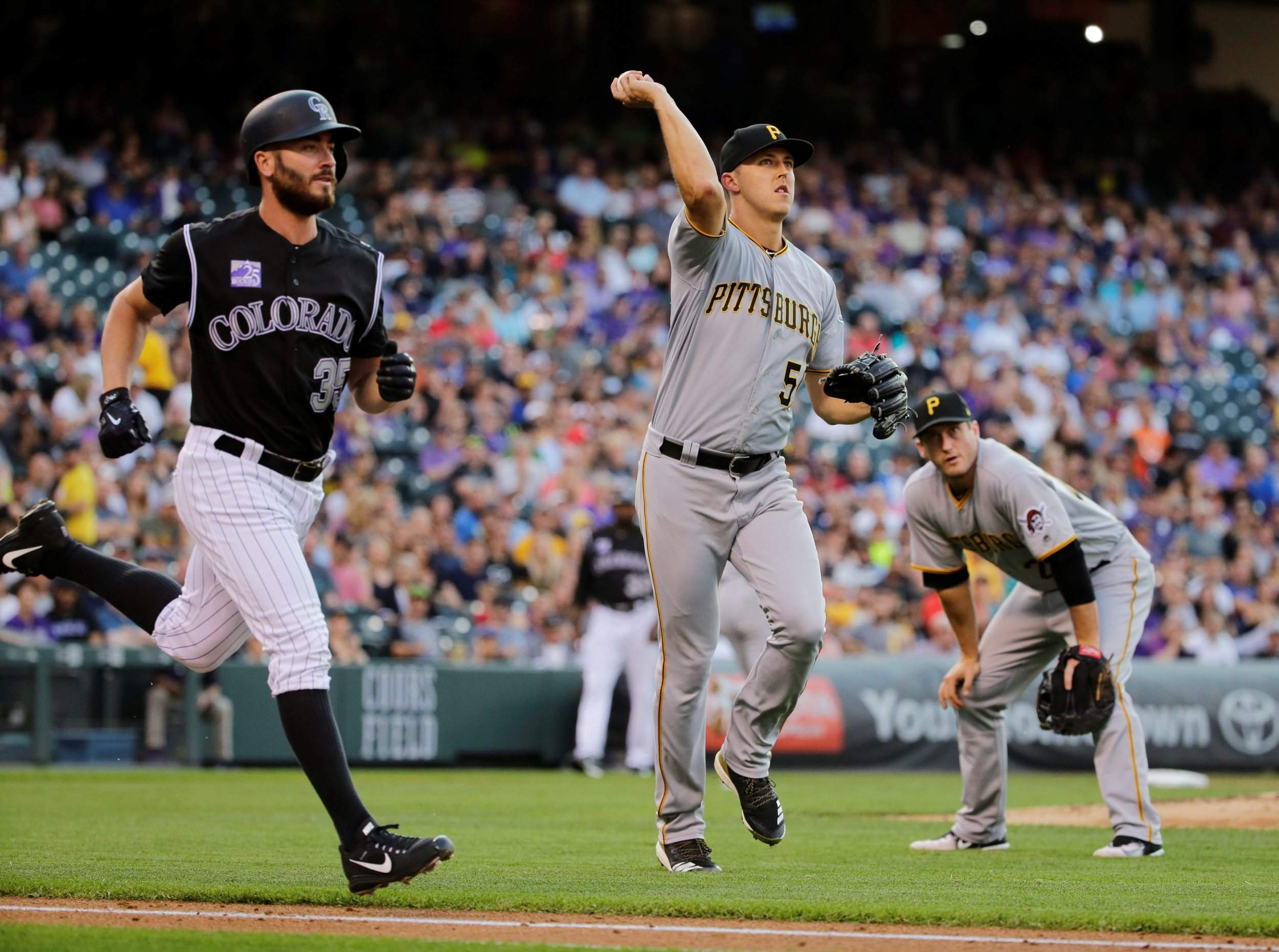 3444512d51cb0 Pittsburgh Pirates starting pitcher Jameson Taillon throws out Colorado  Rockies  Chad Bettis