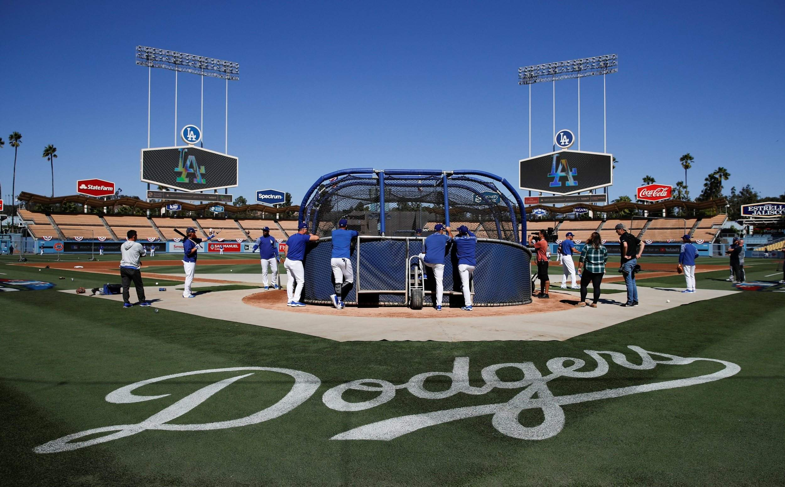 Los Angeles Dodgers take batting practice before Game 3 of the National League Championship Series against the Milwaukee Brewers on Monday in Los Angeles.