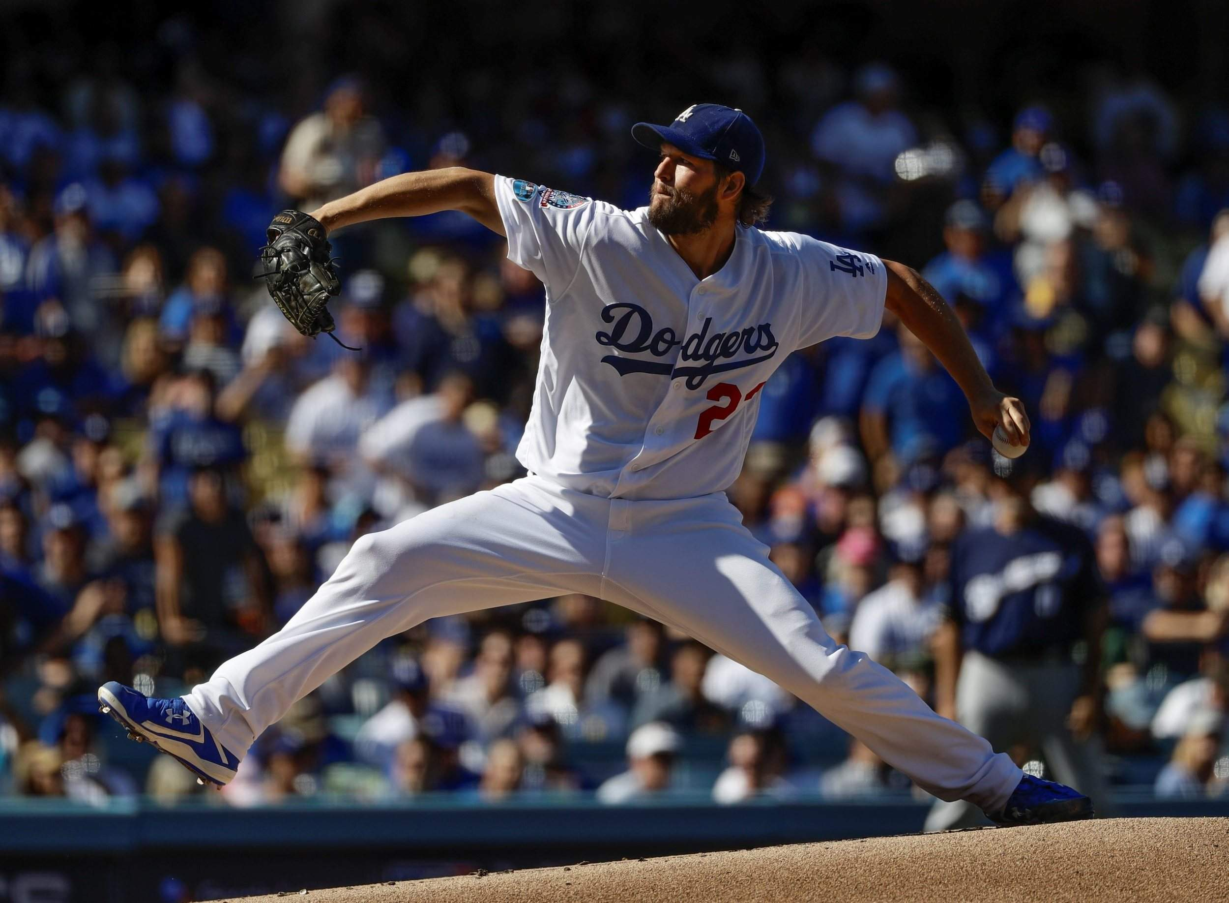 clayton kershaw delivers, dodgers beat brewers to take nlcs leadlos angeles dodgers starting pitcher clayton kershaw pitches during the first inning of game 5 of the national league championship series against the