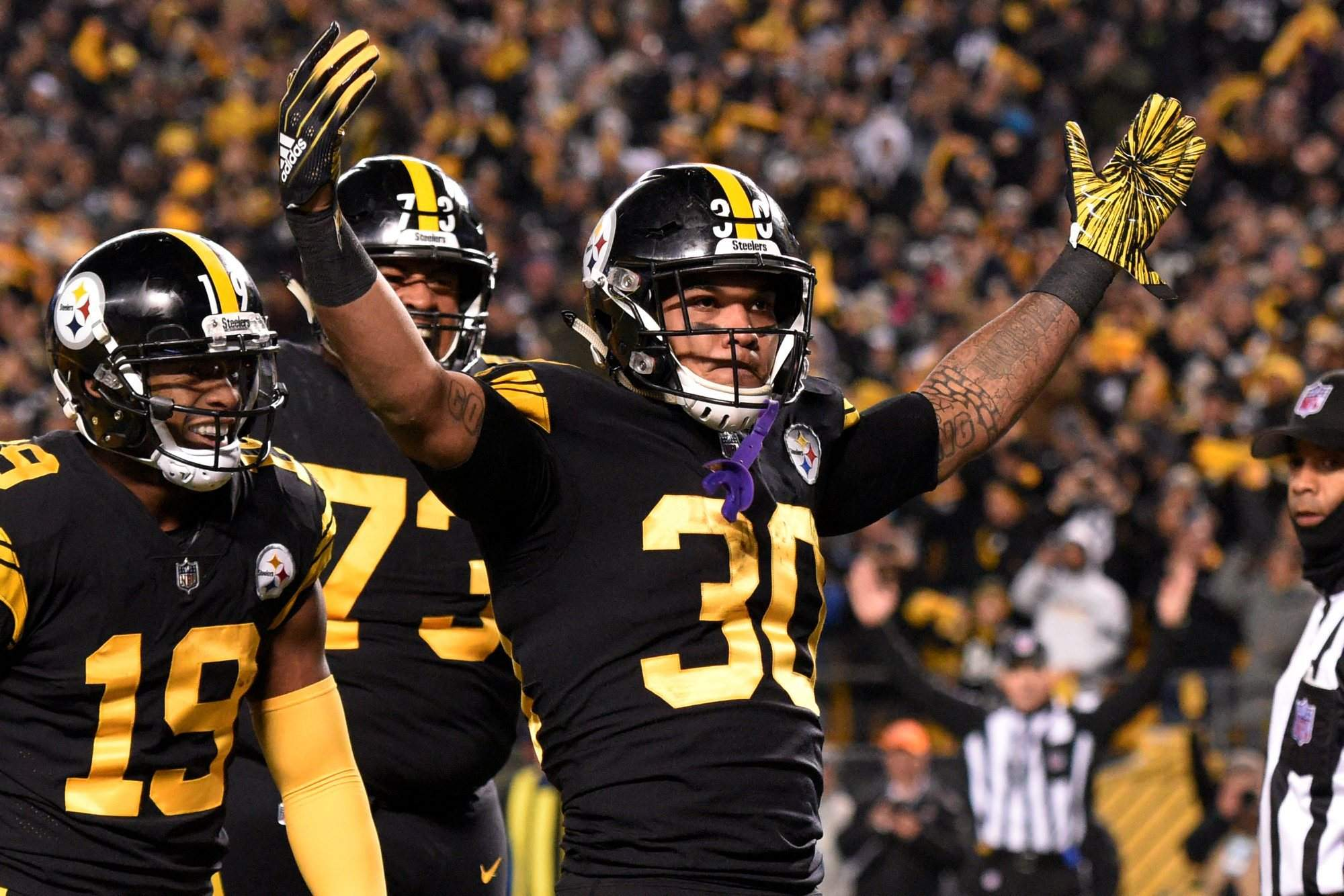 345f45a6d06 Pittsburgh Steelers running back James Conner (30) celebrates his touchdown  against the Carolina Panthers during the first half Thursday in Pittsburgh.