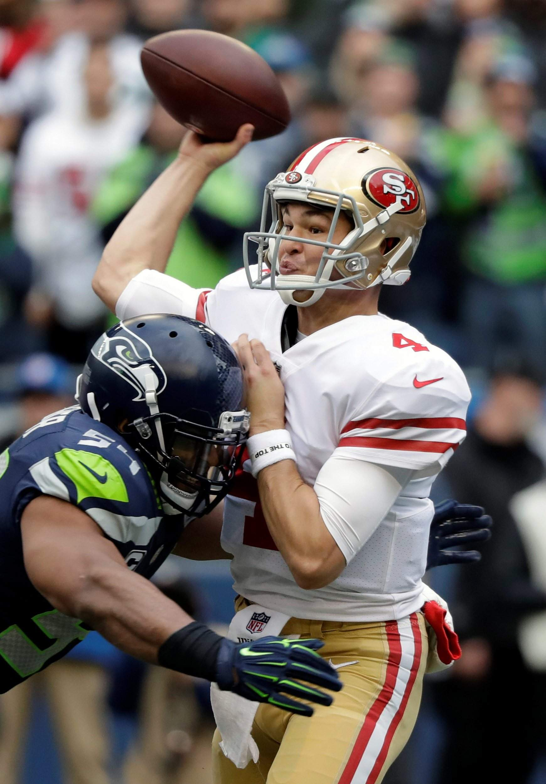 cc2645bd5db San Francisco 49ers quarterback Nick Mullens passes under pressure from  Seattle Seahawks middle linebacker Bobby Wagner during the first half in  Seattle ...