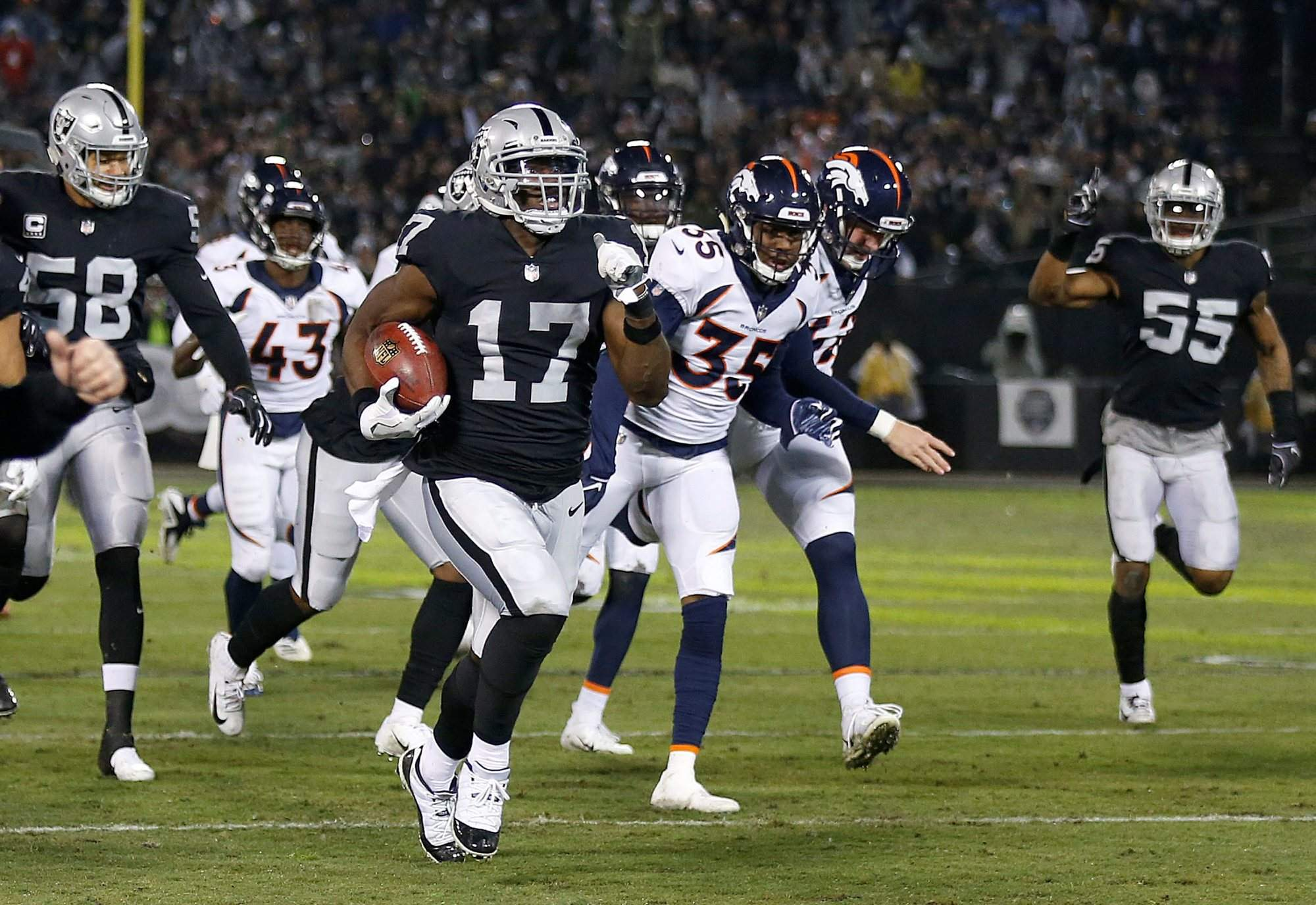 Oakland Raiders  Dwayne Harris returns a punt for a touchdown against the  Denver Broncos during the first half of Monday night s game in Oakland 9b2ab029e