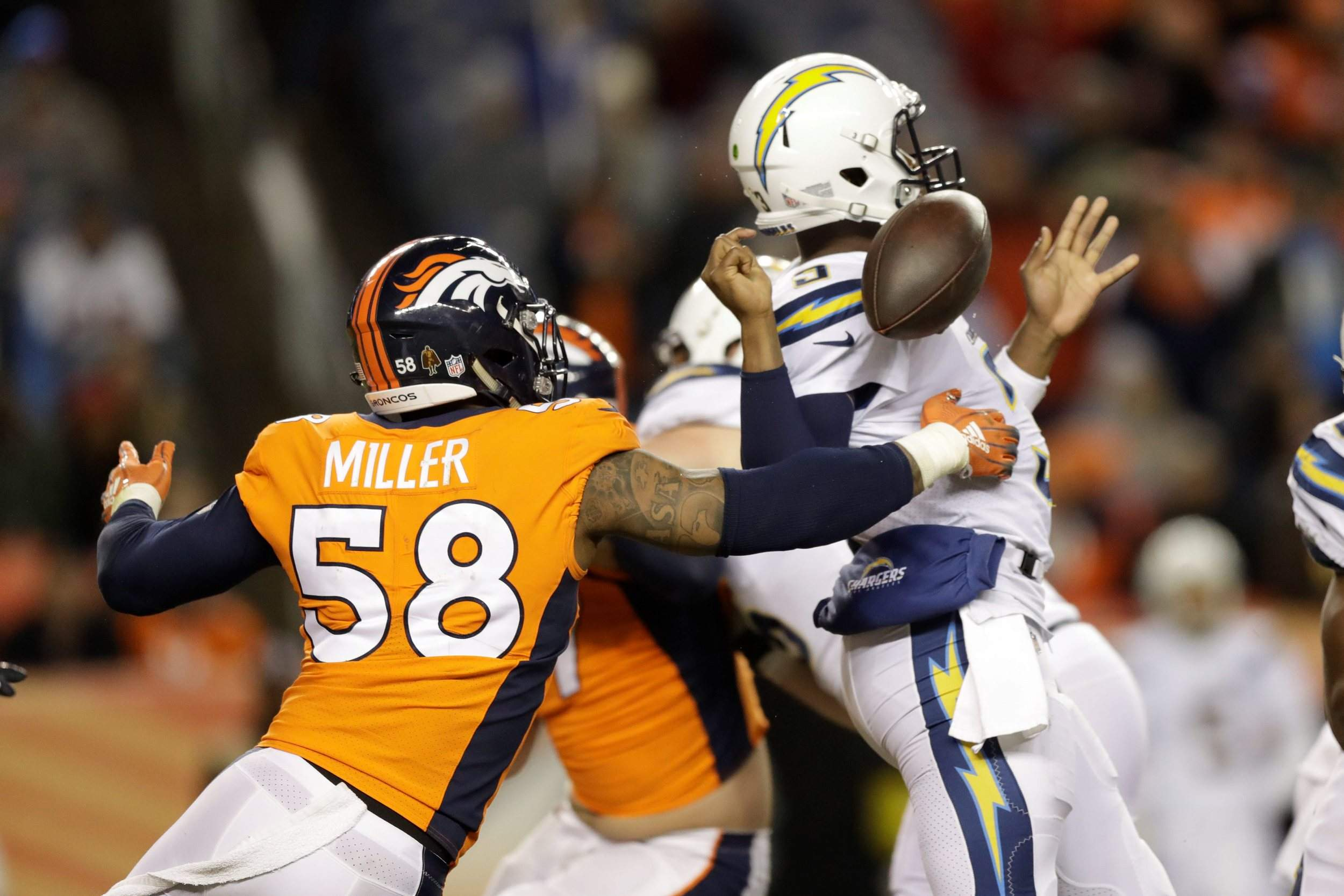 6071fbf277e Denver Broncos outside linebacker Von Miller hits Los Angeles Chargers  quarterback Geno Smith during the second half Sunday in Denver. Miller  recovered the ...