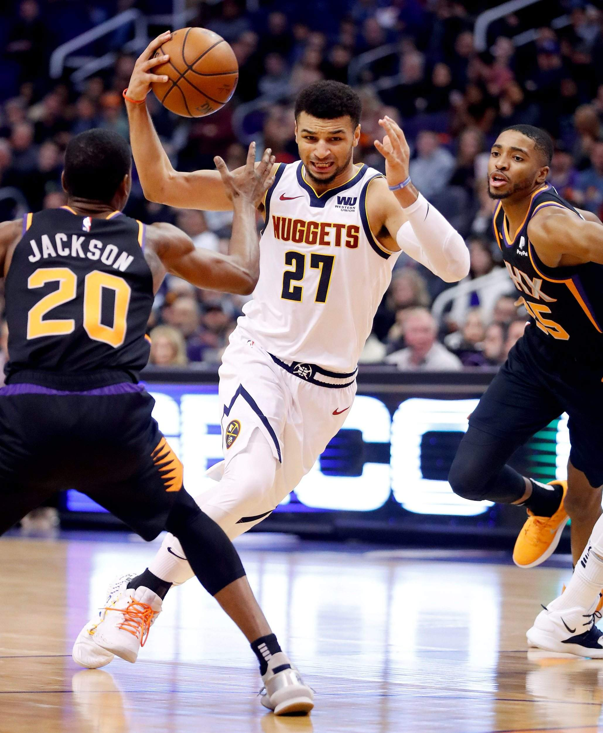 5bbae2e22af5 Denver Nuggets guard Jamal Murray (27) drives against Phoenix Suns forward Josh  Jackson (20) during the first half Saturday. Murray had 46 points to lead  ...