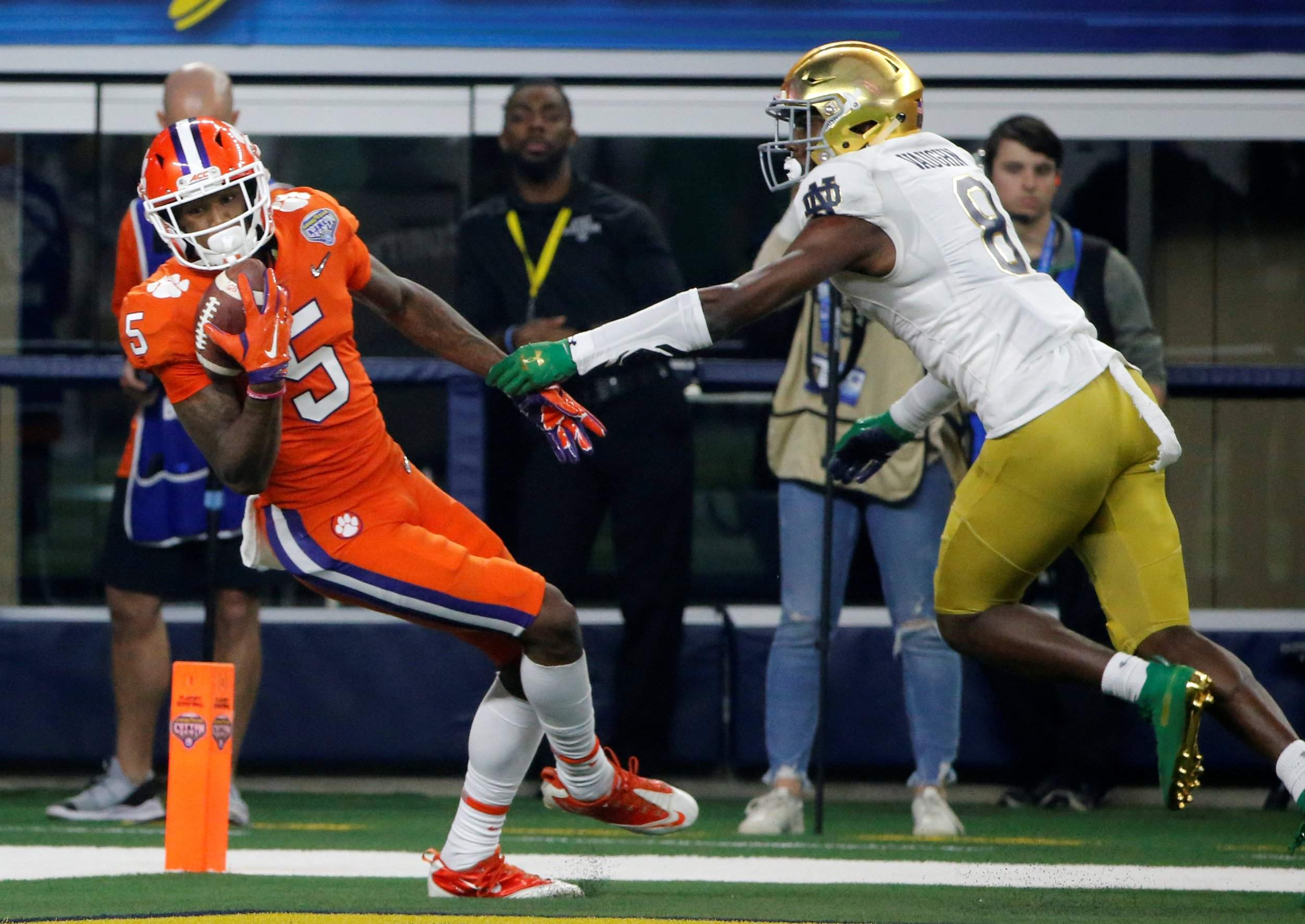 Clemson wide receiver Tee Higgins (5) comes down with control of the ball  that was tipped by Notre Dame cornerback Donte Vaughn (8) in the end zone  for a ... 0ea94f8eb