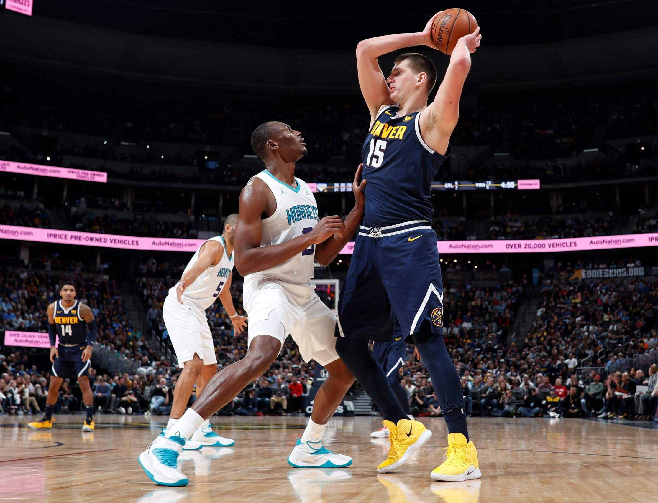 82355b05b Denver Nuggets center Nikola Jokic looks to pass the ball as Charlotte  Hornets center Bismack Biyombo defends in the second half Saturday in Denver .