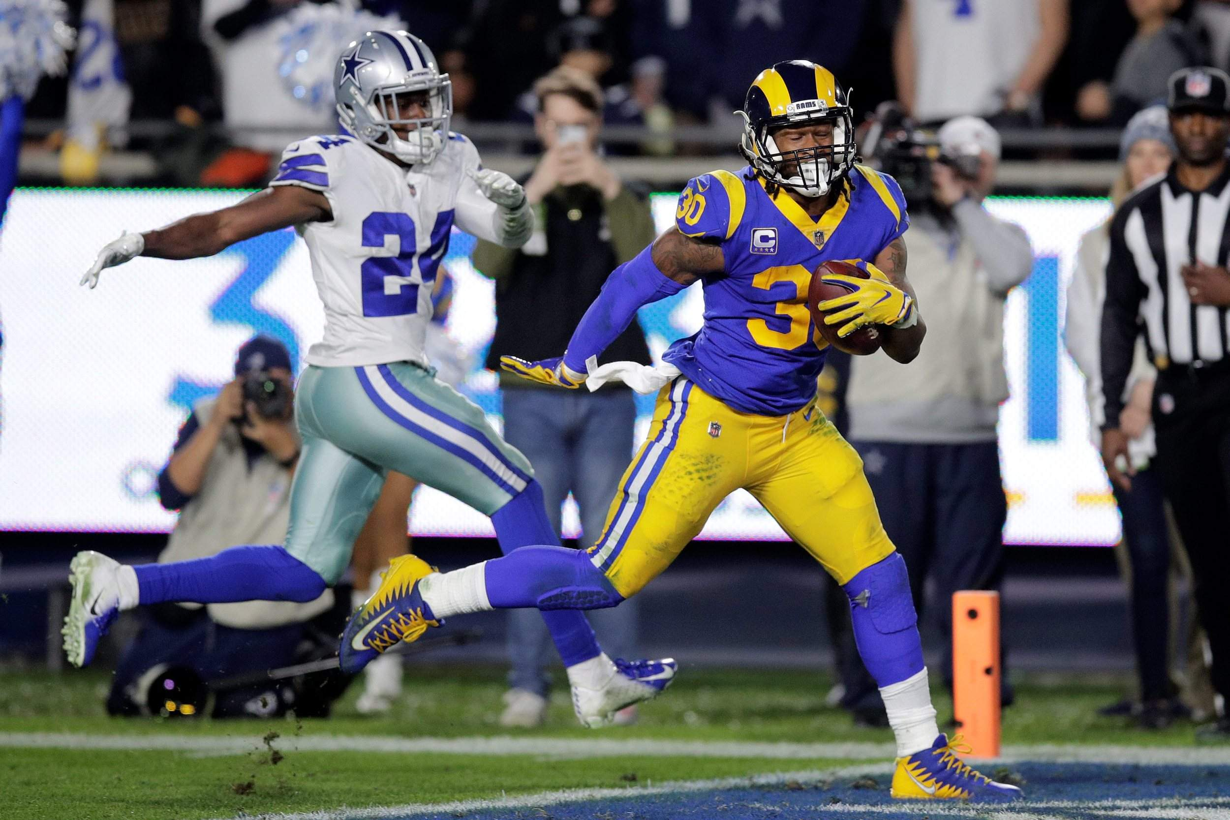 a4576ca88ee Los Angeles Rams running back Todd Gurley scores past Dallas Cowboys  cornerback Chidobe Awuzie during the first half Saturday in Los Angeles.