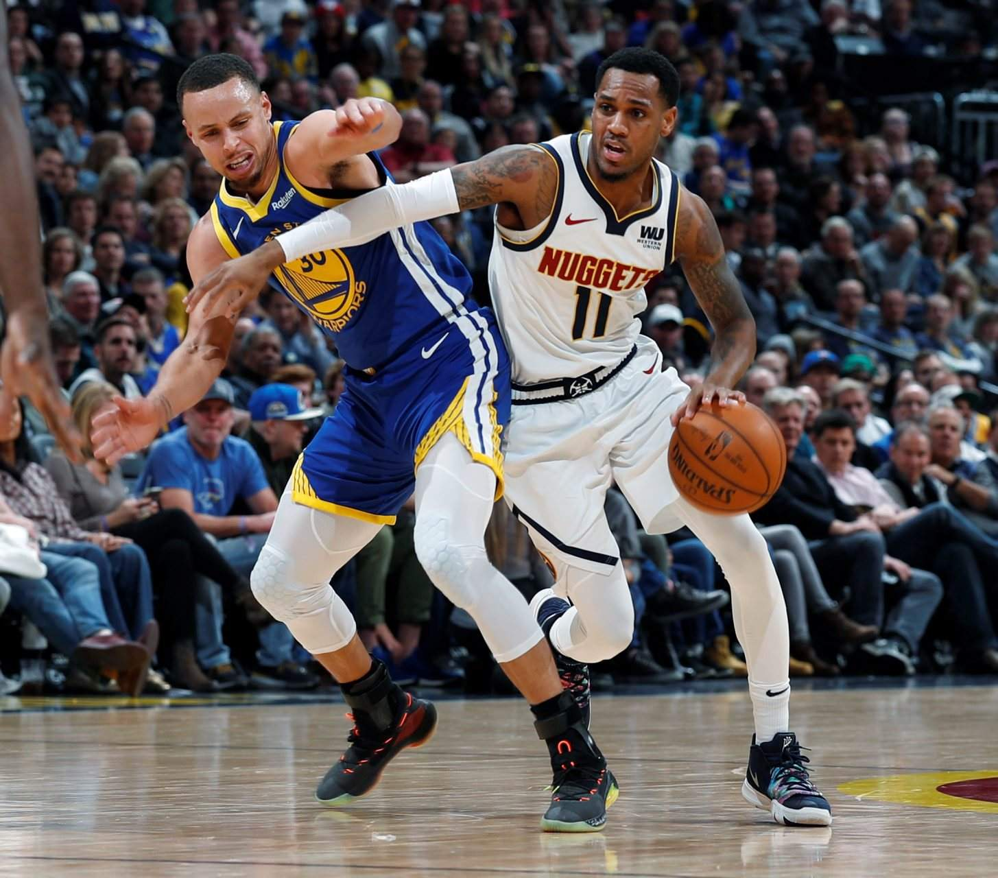 59524883a Denver Nuggets guard Monte Morris drives past Golden State Warriors guard  Stephen Curry in the second half of last week s game in Denver.