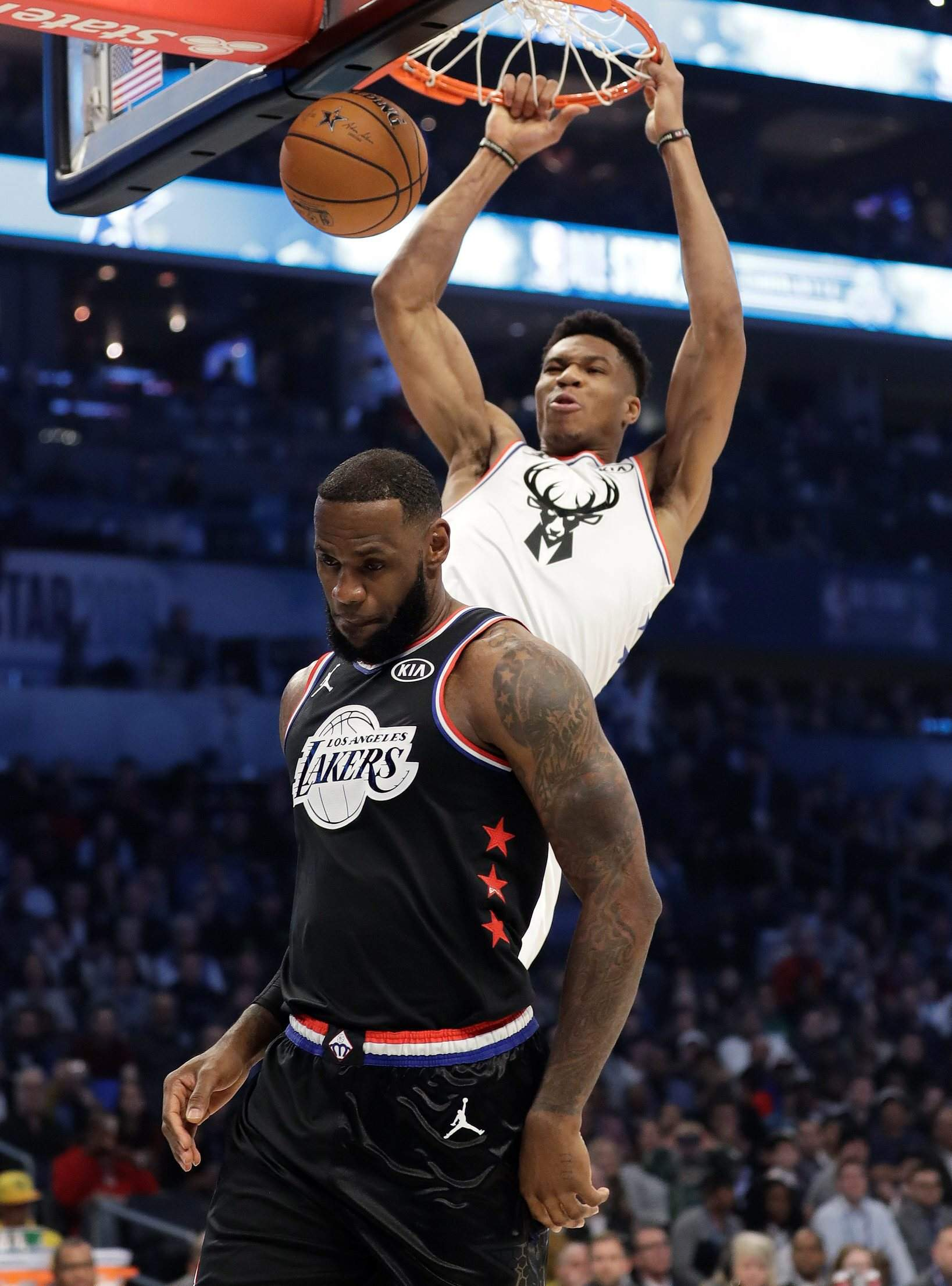 66a7060acab Team Giannis' Giannis Antetokounmpo, of the Milwaukee Bucks, dunks the ball  against Team LeBron's LeBron James, of the Cleveland Cavaliers, during the  first ...