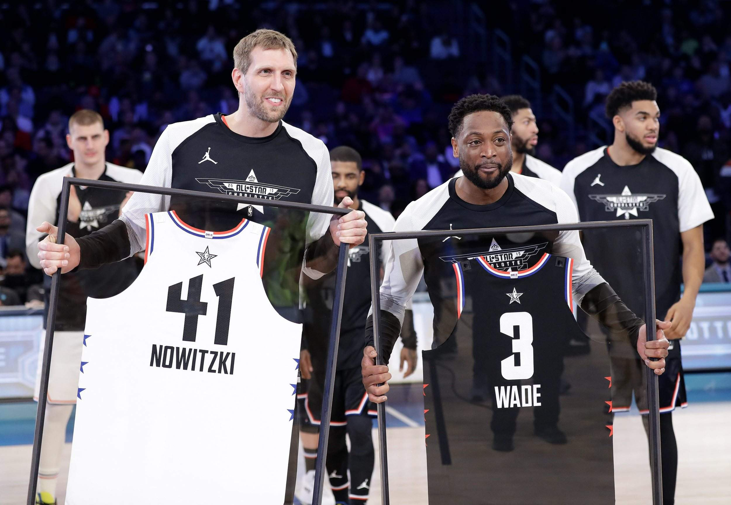 3a573c367d4 Team Giannis' Dirk Nowitzki, of the Dallas Mavericks and Team LeBron's  Dwyane Wade, of the Miami Heat are given jerseys during the second half of  Sunday's ...