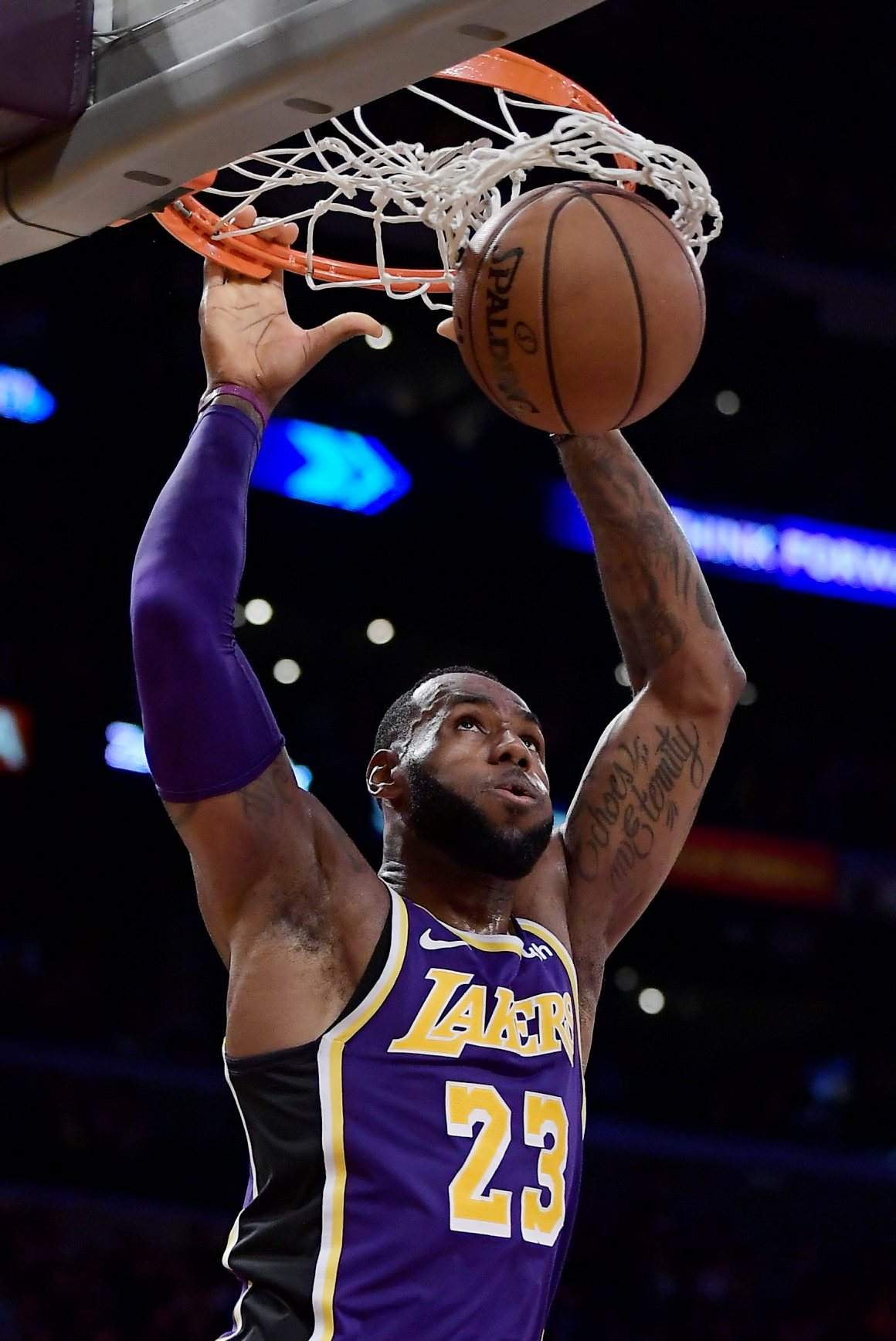 b506b3f5021 Los Angeles Lakers forward LeBron James dunks during the second half of  Wednesday s game against the Denver Nuggets in Los Angeles. The Nuggets won  115-99.