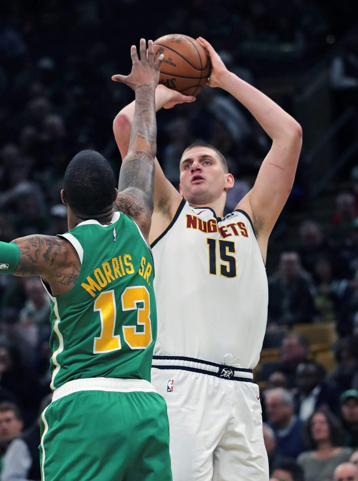5592c1baa Denver Nuggets center Nikola Jokic shoots over Boston Celtics forward  Marcus Morris during the second half Monday s game in Boston.